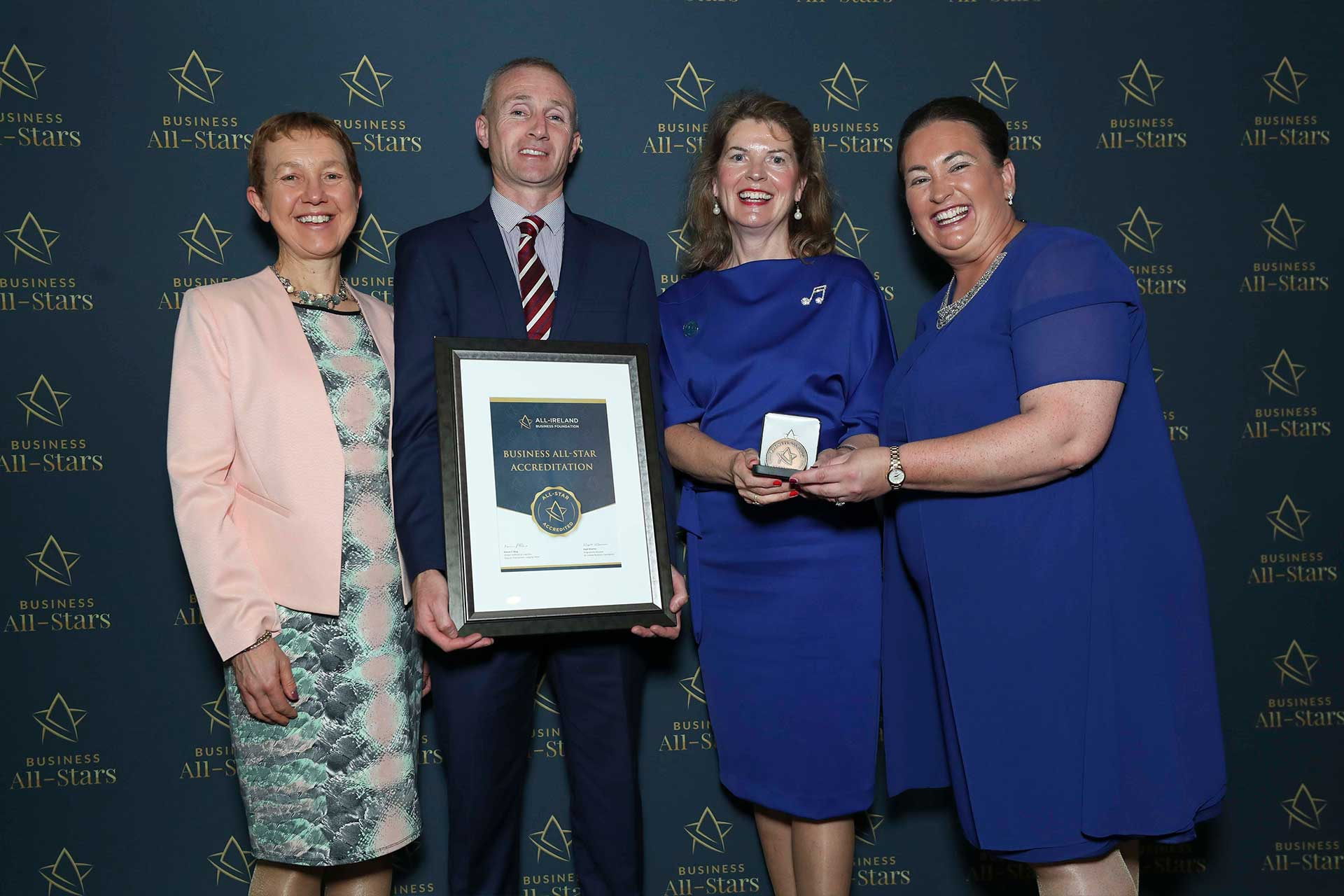 Micéal Stapleton and Mary Walsh - Ire Wel Pallets receiving Business All-Star Accreditation at Croke Park from Dr Briga Hynes, Kemmy Business School, University of Limerick and Elaine Carroll CEO, All-Ireland Business Foundation.