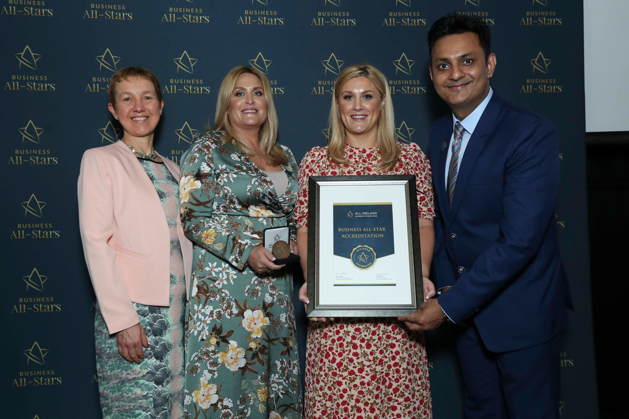 Aishling Naughton & Michelle Daly, P&G Cards receiving Business All-Star Accreditation at Croke Park from Dr Briga Hynes, Kemmy Business School University of Limerick and Kapil Khanna, MD, All-Ireland Business Foundation.