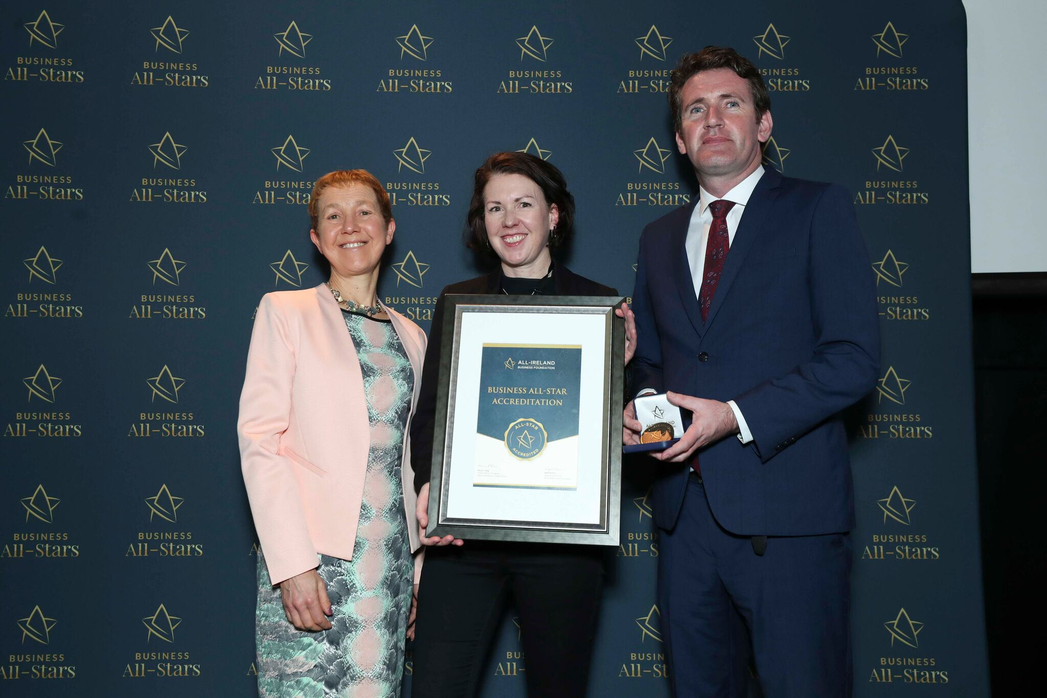 Aoife Gaffney - Prudence Moneypenny Coaching receiving Business All-Star Thought Leader Accreditation at Croke Park from Dr Briga Hynes, Kemmy Business School, University of Limerick and Senator Aodhán Ó Ríordáin, Spokesperson on Education and Skills, Gaeilge and the Gaeltacht.