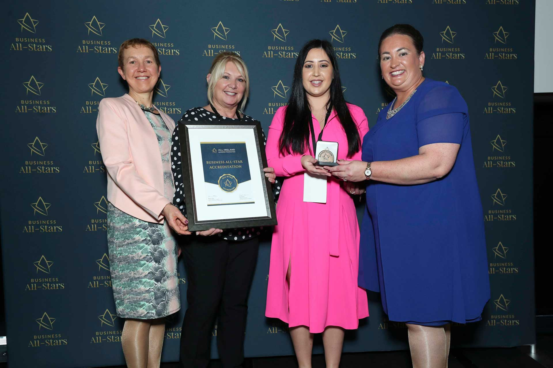 Michelle Kerslake & team- Beautique Beauty Studio receiving Business All-Star Accreditation at Croke Park from Dr Briga Hynes, Kemmy Business School, University of Limerick and CEO of AIBF, Elaine Carroll.