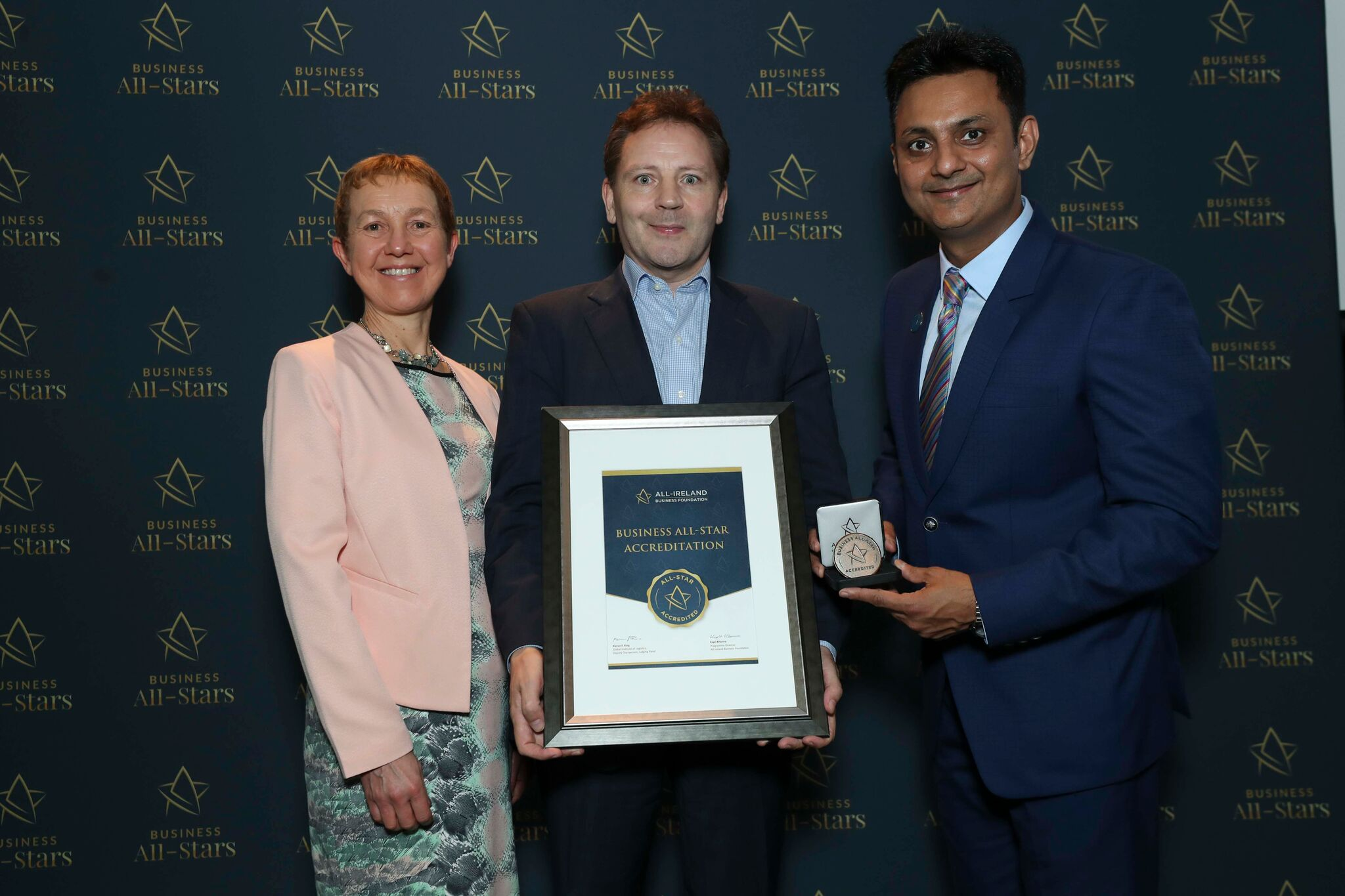 Kevin Neary, Orcawise receiving Business All-Star Accreditation at Croke Park from Dr Briga Hynes, Kemmy Business School University of Limerick and Kapil Khanna, MD, All-Ireland Business Foundation.