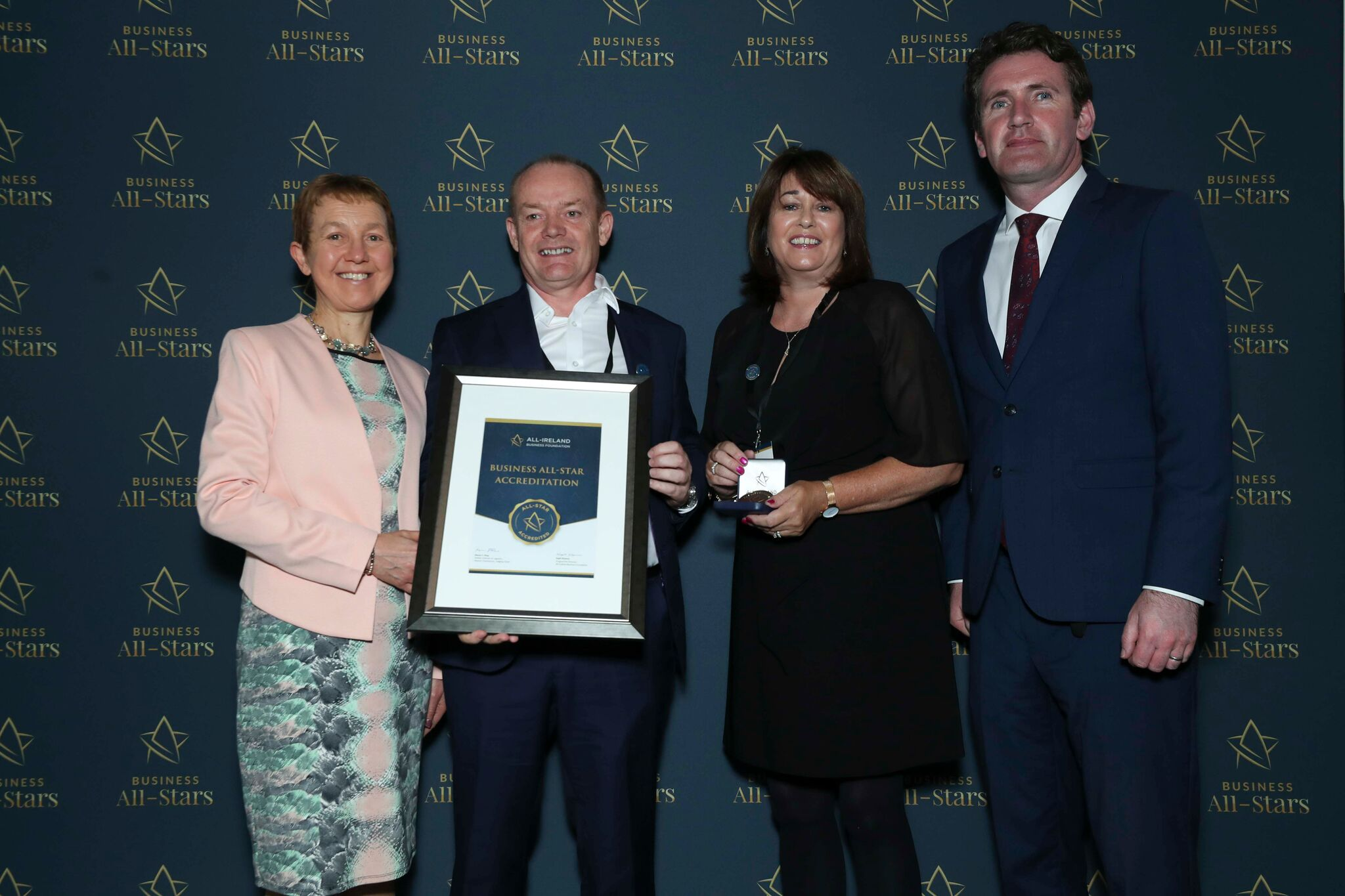 Brian & Theresa Colbert- Irish Institute of NLP receiving Business All-Star Accreditation at Croke Park from Dr Briga Hynes, Kemmy Business School, University of Limerick and Senator Aodhán Ó Ríordáin, Spokesperson on Education and Skills, Gaeilge and the Gaeltacht.