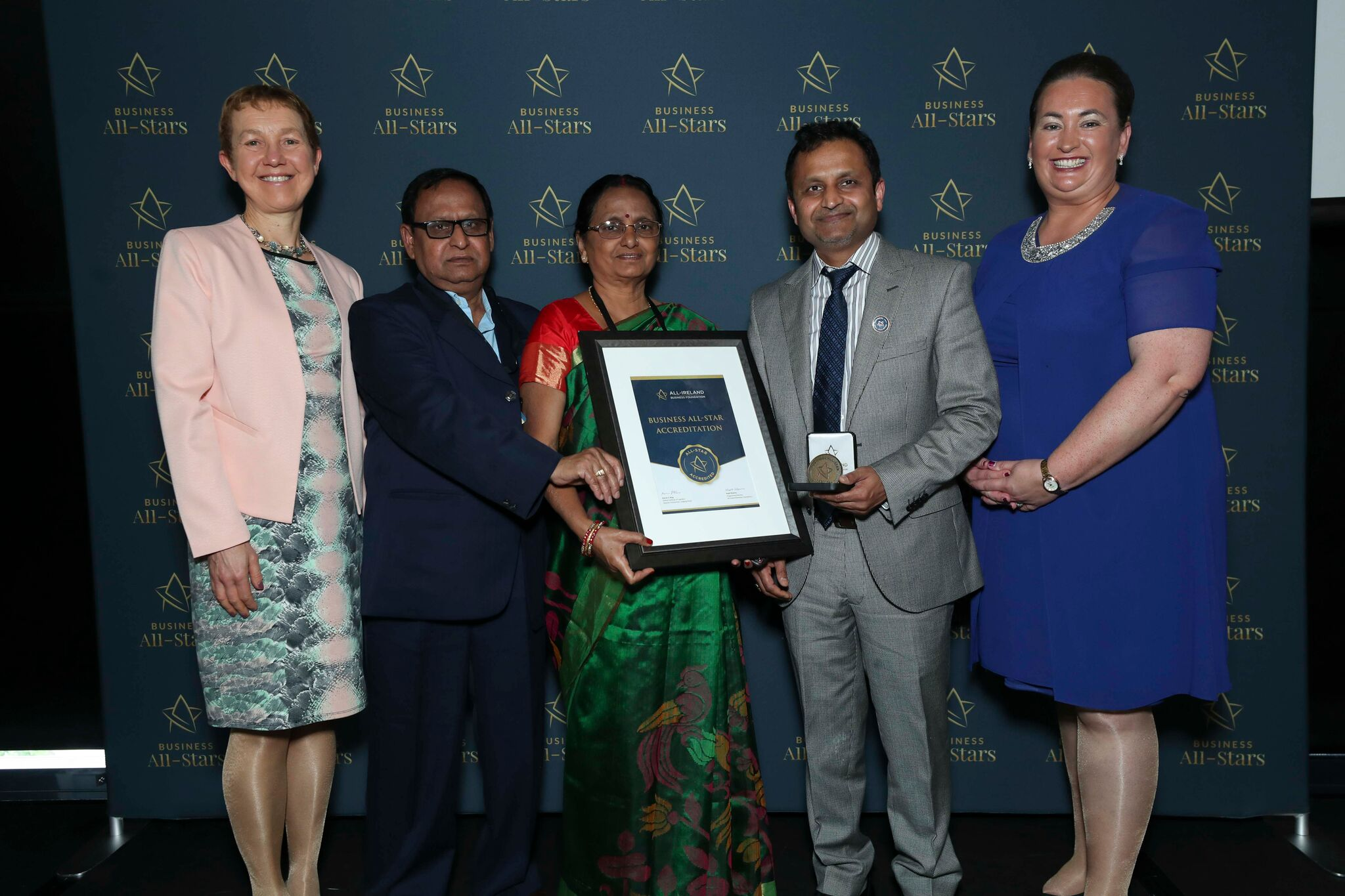 Dr Deepak Kumar & his parents - The Audiology Clinic representing receiving Business All-Star Accreditation at Croke Park from Dr Briga Hynes, Kemmy Business School, University of Limerick and Elaine Carroll CEO, All-Ireland Business Foundation.