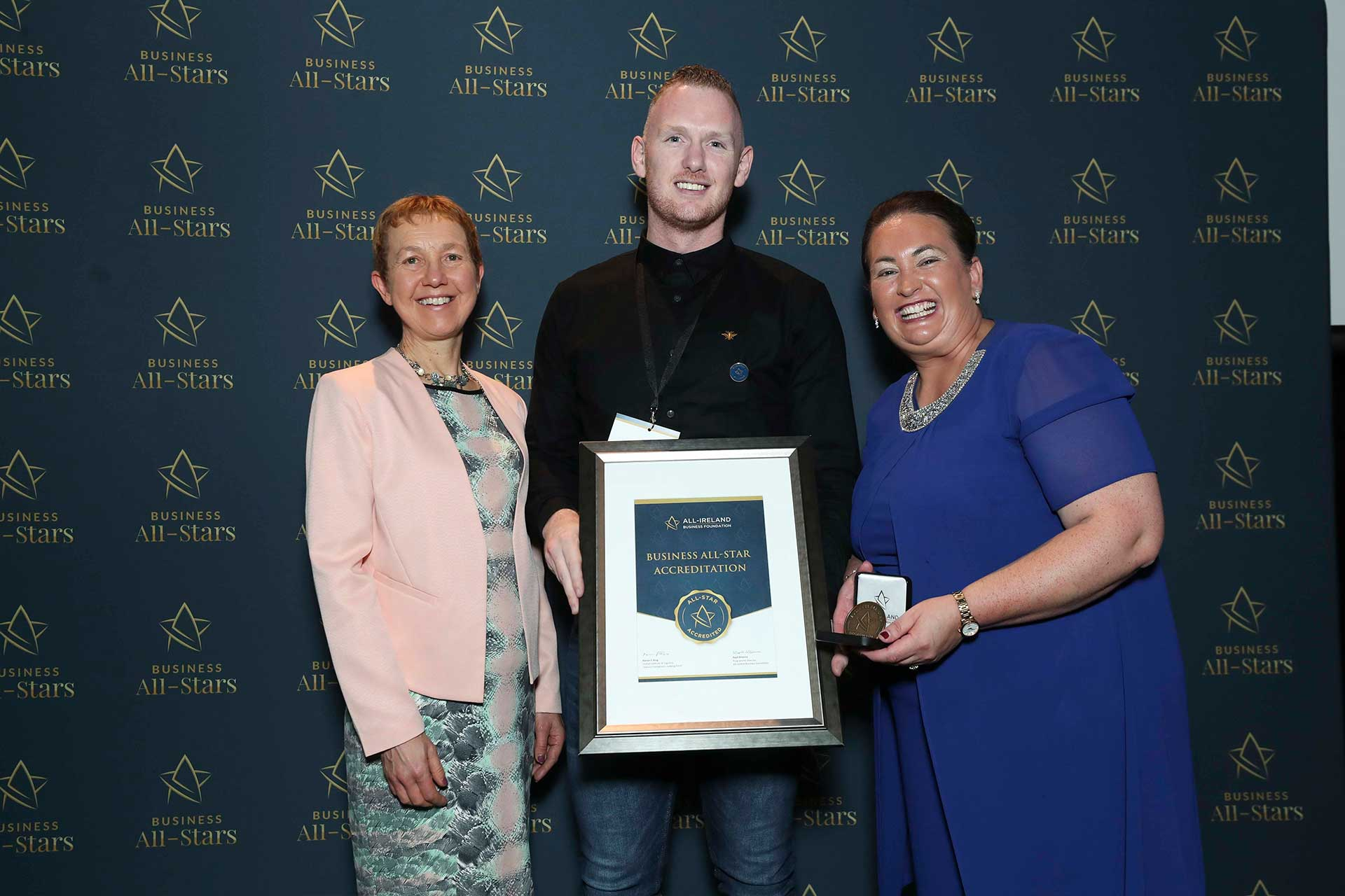 David Roche - Roche Injury Clinic receiving Business All-Star Thought Leader Accreditation at Croke Park from Dr Briga Hynes, Kemmy Business School, University of Limerick and Elaine Carroll CEO, All-Ireland Business Foundation.