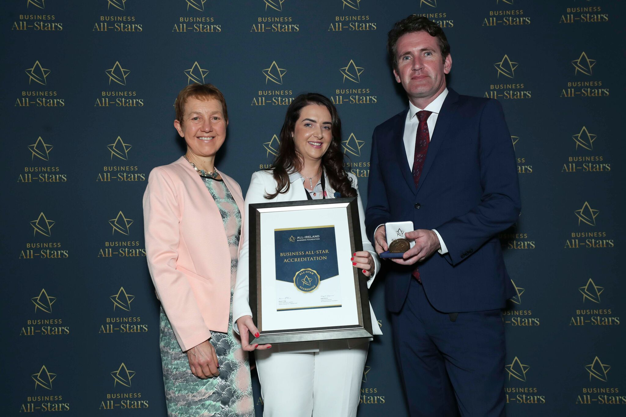 Charlene McMahon - Touch and Glow Skin and Laser receiving Business All-Star Accreditation at Croke Park from Dr Briga Hynes, Kemmy Business School, University of Limerick and Senator Aodhán Ó Ríordáin, Spokesperson on Education and Skills, Gaeilge and the Gaeltacht.