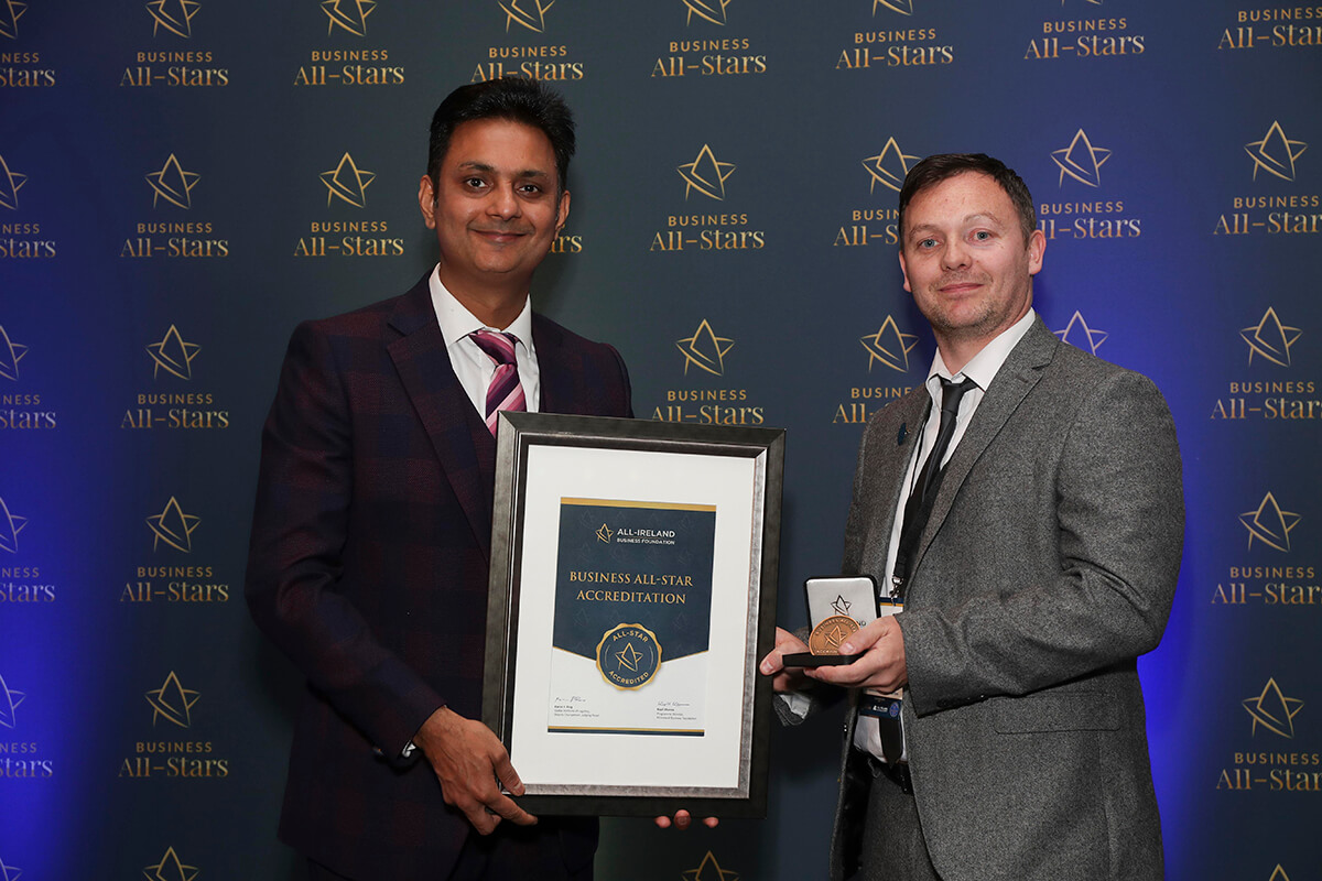 CAPTION: Daniel Davern - DX2 Training, receiving Business All-Star Accreditation from Kapil Khanna, MD, AIBF at Croke Park