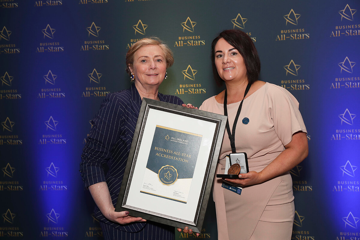 CAPTION: Laura Kinsella - LMK Skin, receiving Business All-Star Thought Leader Accreditation from Frances Fitzgerald, MEP, at Croke Park