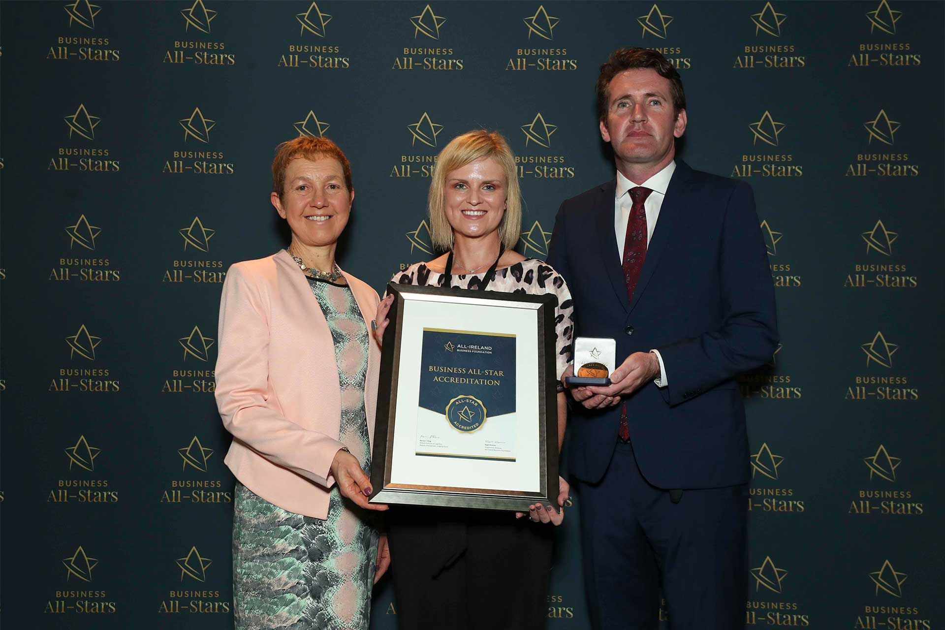 Aisling Griffin - Treetop Studio receiving Business All-Star Accreditation at Croke Park from Dr Briga Hynes, Kemmy Business School, University of Limerick and Senator Aodhán Ó Ríordáin, Spokesperson on Education and Skills, Gaeilge and the Gaeltacht.