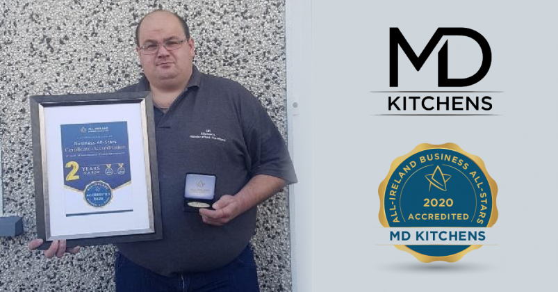 Michael Doyle, Owner of MD Kitchens photographed with his All-Star Accreditation certificate and medallion.