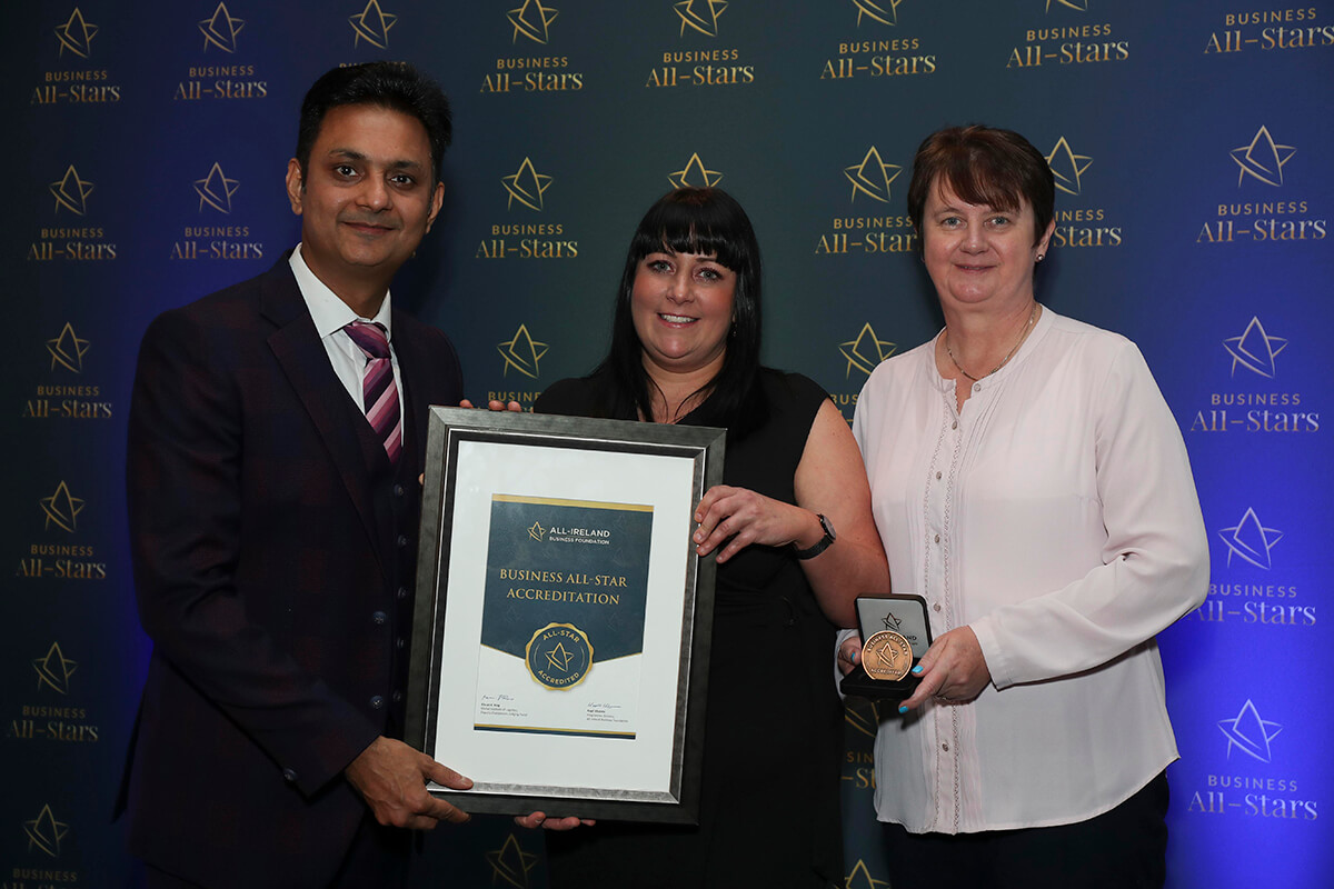 CAPTION: Melissa Walsh - Mw Design, Print & Signs receiving Business All-Star Thought Leader Accreditation from Kapil Khanna, MD, AIBF at Croke Park