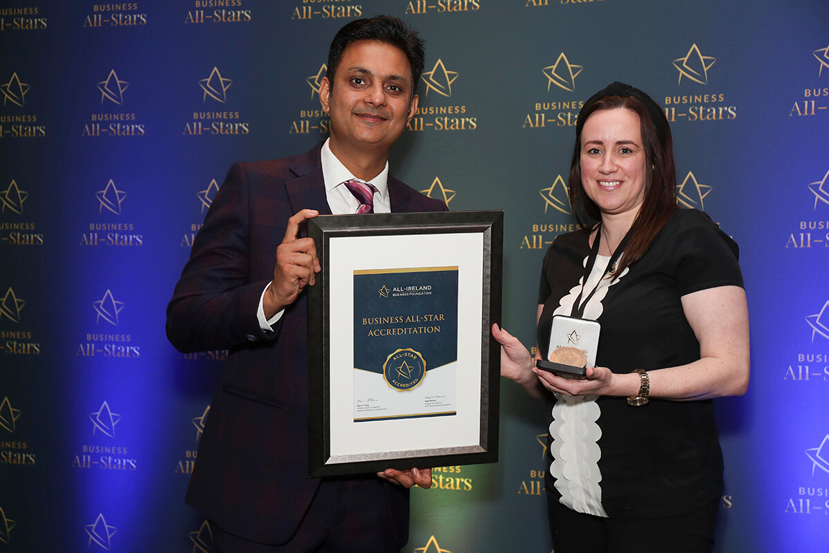 CAPTION: Laura Quinn - Monkey Blue Press receiving Business All-Star Accreditation from Kapil Khanna, MD, AIBF at Croke Park