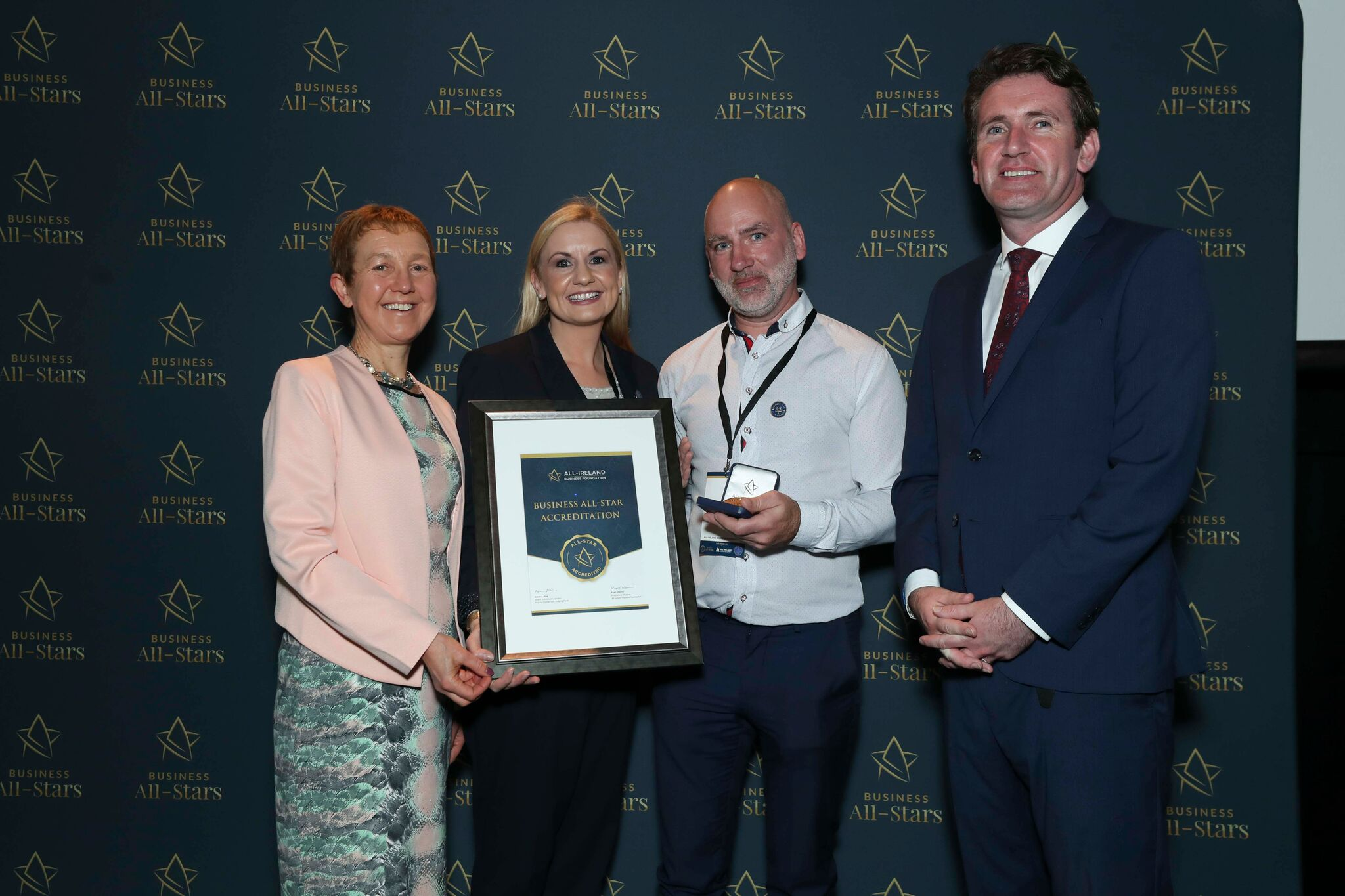 Orla Cunnigham & Ronan O Grady - All In Design & Print receiving Business All-Star Accreditation at Croke Park from Dr Briga Hynes, Kemmy Business School, University of Limerick and Senator Aodhán Ó Ríordáin, Spokesperson on Education and Skills, Gaeilge and the Gaeltacht.