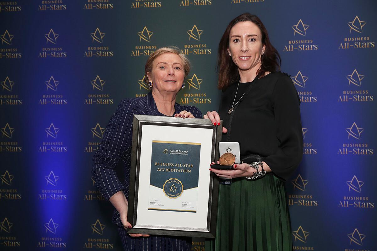 CAPTION: Anita Finnegan - Nova Leah, receiving Business All-Star Accreditation from Frances Fitzgerald, MEP, at Croke Park