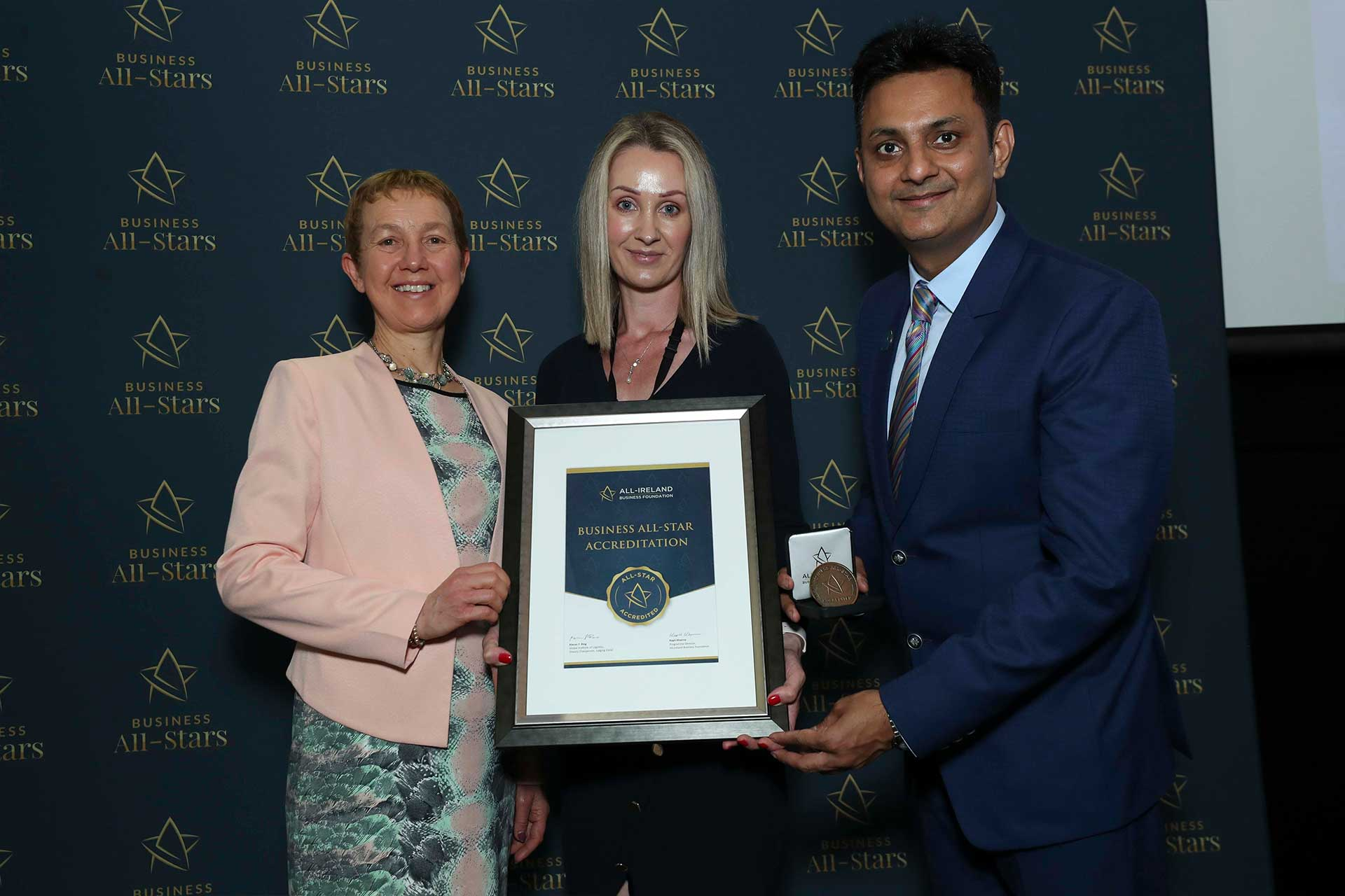 Liz Cronin, Revive Clinic receiving Business All-Star Accreditation at Croke Park from Dr Briga Hynes, Kemmy Business School University of Limerick and Kapil Khanna, MD, All-Ireland Business Foundation.