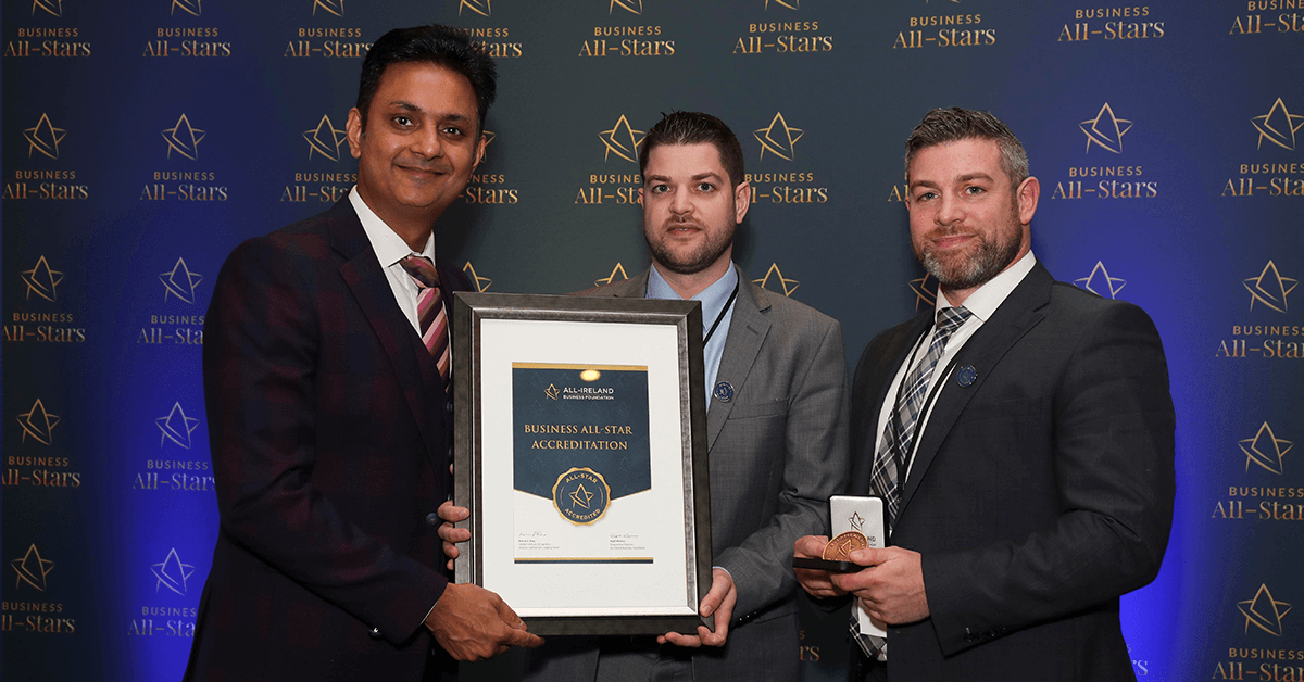 CAPTION: Richard & Ross O'Boyle - Power Right Fire Energy & Security receiving Business All-Star Accreditation from Kapil Khanna, MD, AIBF at Croke Park