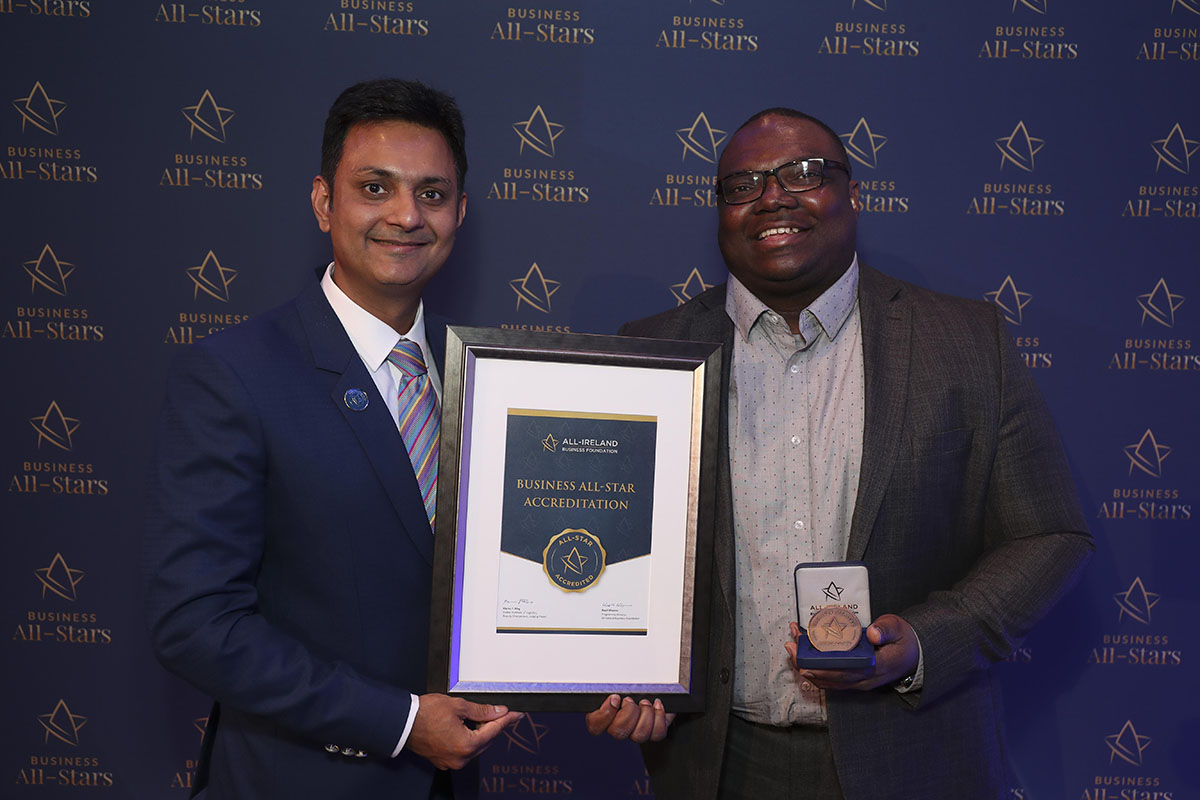 Kapil Khanna, MD of AIBF handing Bassey Duke, MD of Pruune Consulting his All-Star Accreditation certificate at Croke Park, Dublin.