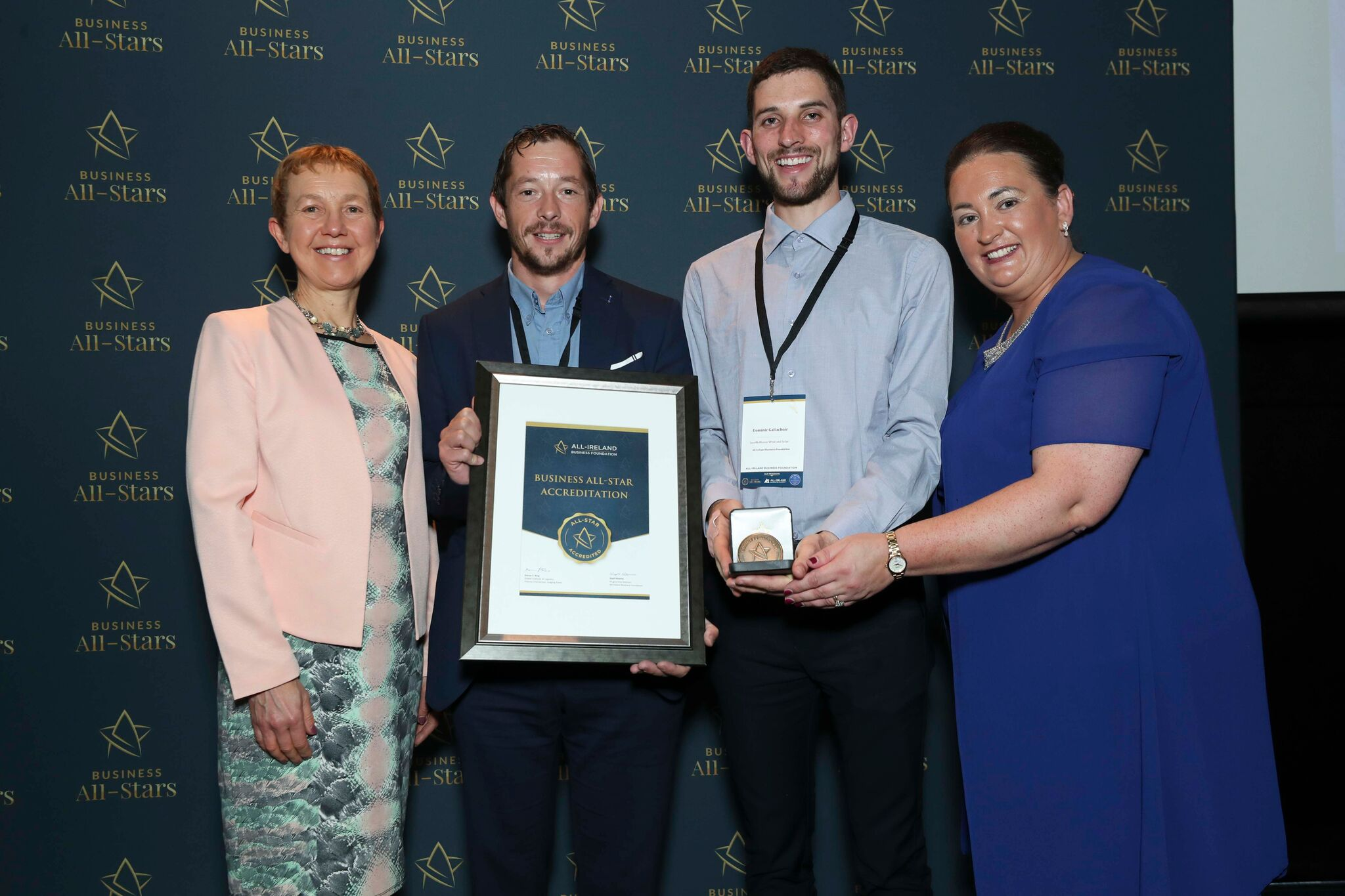 Zoltan Nemeth and Dominic Gallachoir - SaveMeMoney Wind and Solar receiving Business All-Star Accreditation at Croke Park from Dr Briga Hynes, Kemmy Business School, University of Limerick and Elaine Carroll CEO, All-Ireland Business Foundation.