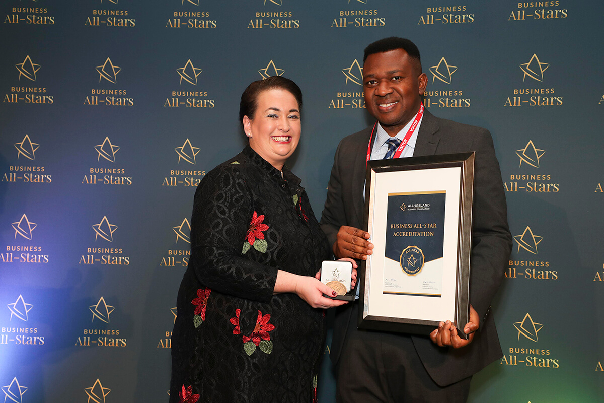 CAPTION: Emeka Ikwukeme - Taxgoglobal Ltd , receiving Business All-Star Thought Leader Accreditation from Elaine Carroll, CEO, All-Ireland Business Foundation at Croke Park.