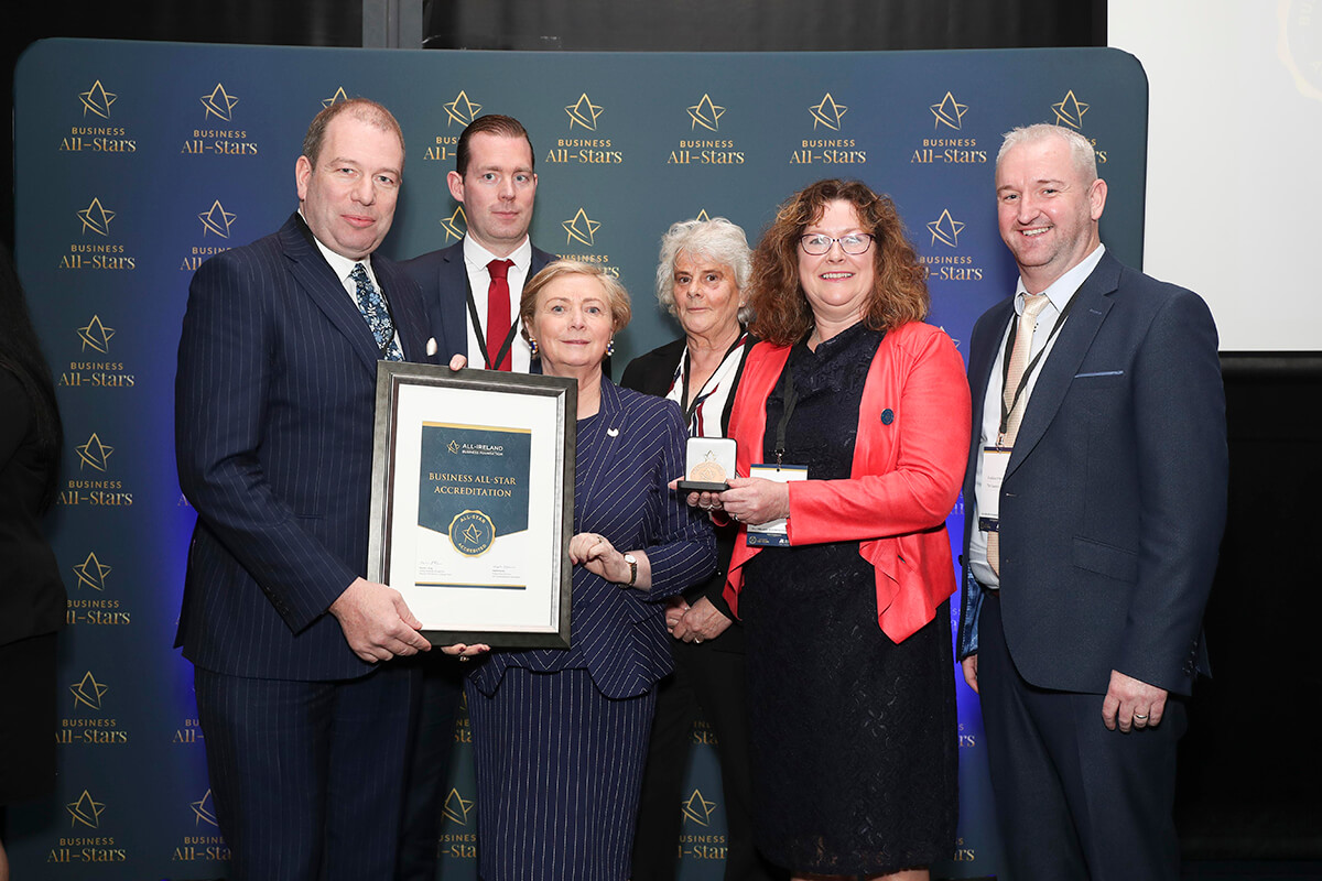 CAPTION: Philip O'Callaghan & team - The Examcraft Group, receiving Business All-Star Accreditation from Frances Fitzgerald, MEP, at Croke Park