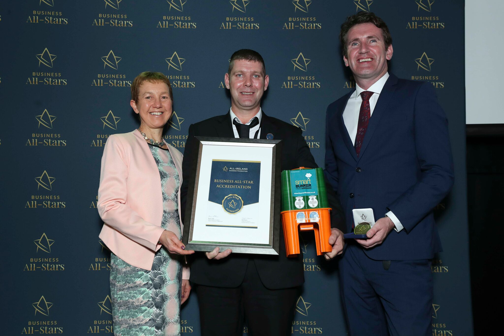 Niall Grennan - The Smart Bunker receiving Business All-Star Accreditation at Croke Park from Dr Briga Hynes, Kemmy Business School, University of Limerick and Senator Aodhán Ó Ríordáin, Spokesperson on Education and Skills, Gaeilge and the Gaeltacht.