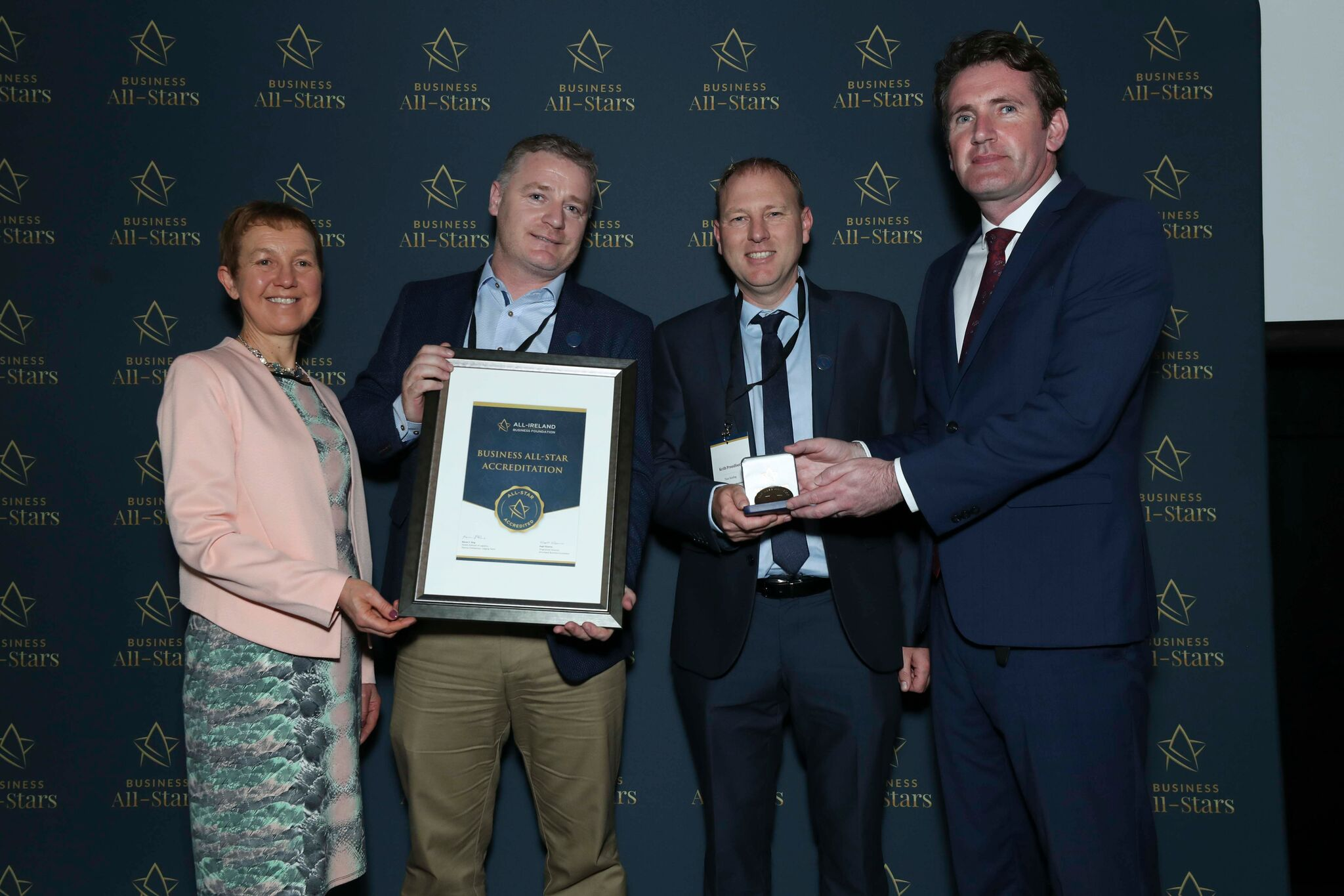 Keith Proudfoot and Stephen Kennedy - Titan Roofing receiving Business All-Star Accreditation at Croke Park from Dr Briga Hynes, Kemmy Business School, University of Limerick and Senator Aodhán Ó Ríordáin, Spokesperson on Education and Skills, Gaeilge and the Gaeltacht.
