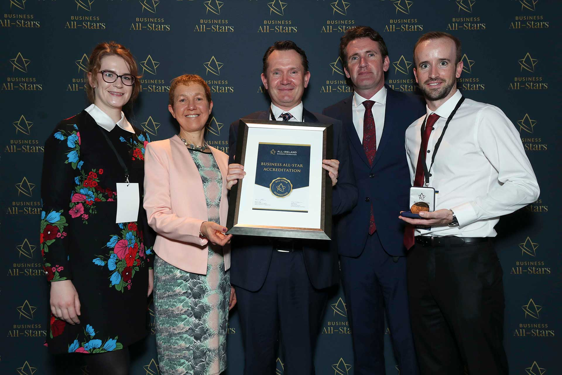 Mike Minihan & team - QPTech Recruitment receiving Business All-Star Accreditation at Croke Park from Dr Briga Hynes, Kemmy Business School, University of Limerick and Senator Aodhán Ó Ríordáin, Spokesperson on Education and Skills, Gaeilge and the Gaeltacht.