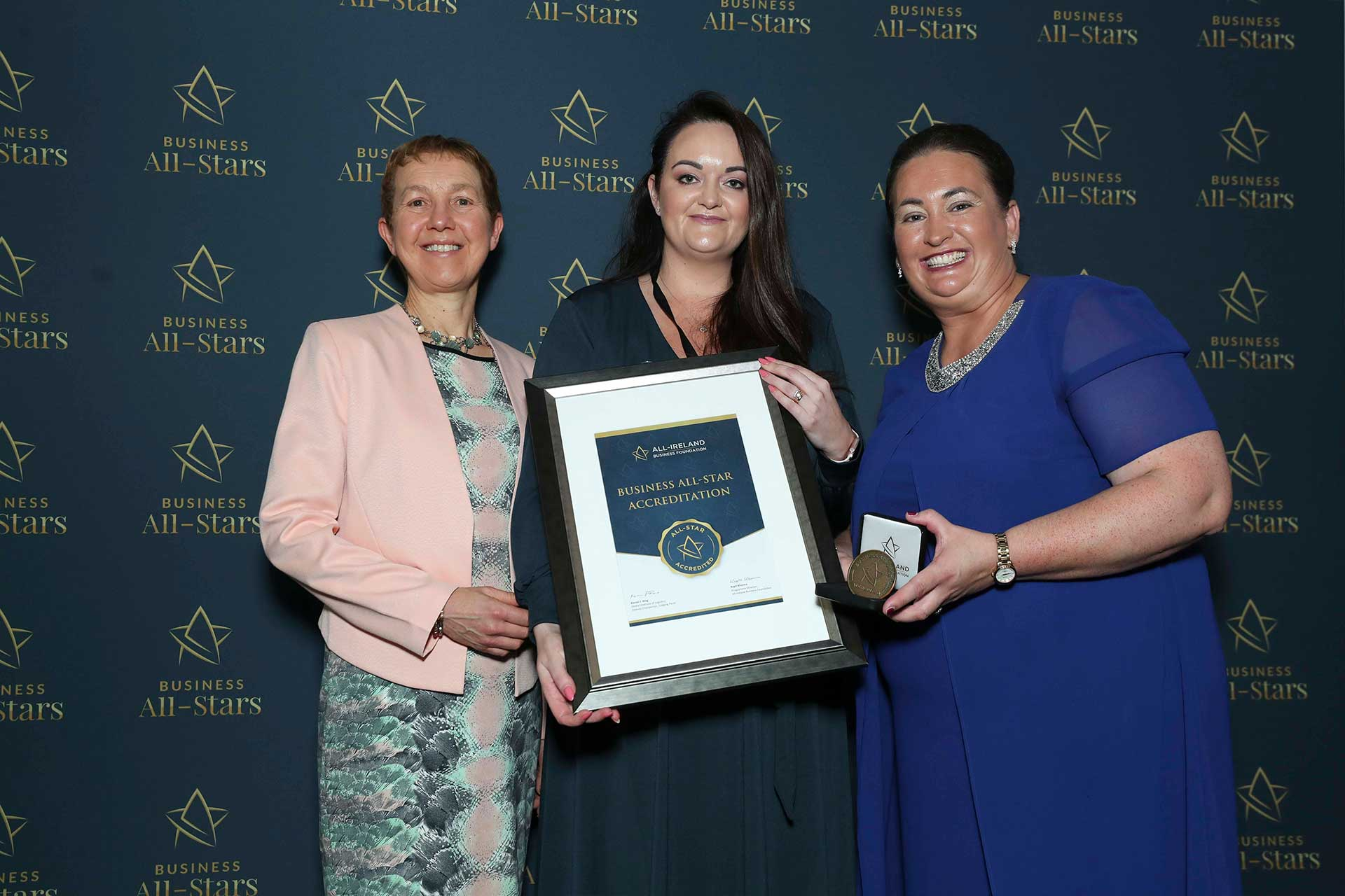 Denise Bennett White - Denises Beauty Clinic receiving Business All-Star Accreditation at Croke Park from Dr Briga Hynes, Kemmy Business School, University of Limerick and Elaine Carroll CEO, All-Ireland Business Foundation.