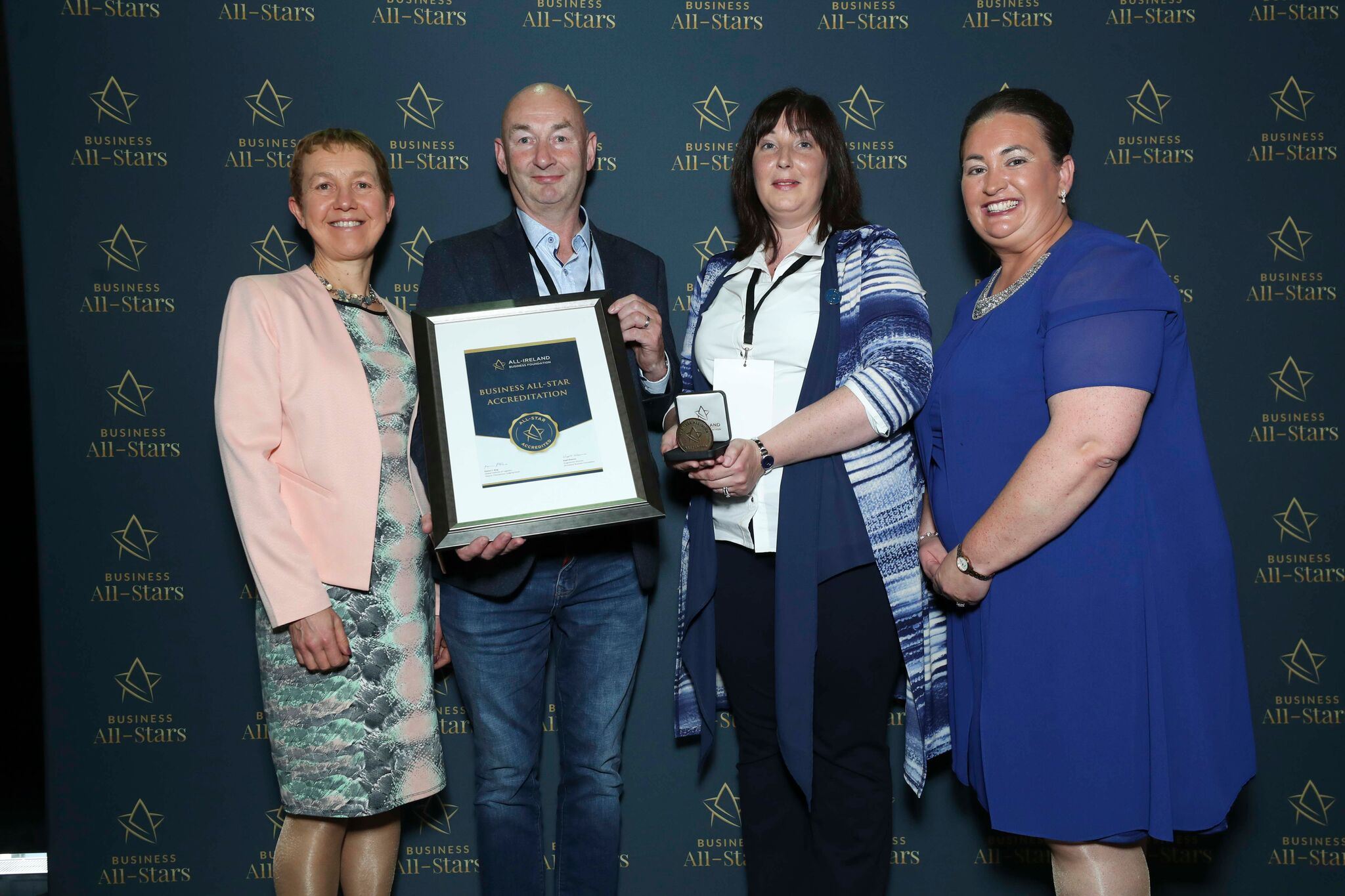 Alan & Louise Dawson - Sheds Direct Ireland representing receiving Business All-Star Accreditation at Croke Park from Dr Briga Hynes, Kemmy Business School, University of Limerick and Elaine Carroll CEO, All-Ireland Business Foundation.