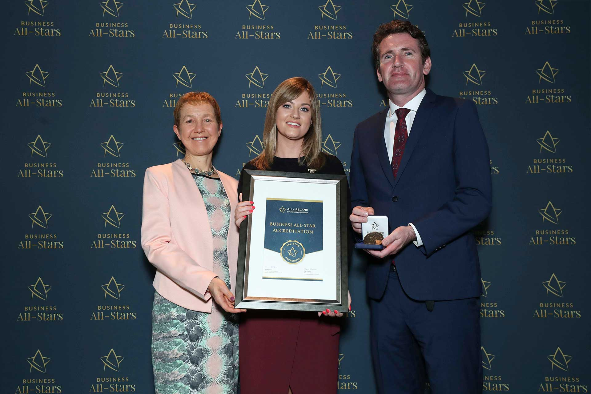 Shauna Coyne - SkyClad receiving Business All-Star Accreditation at Croke Park from Dr Briga Hynes, Kemmy Business School, University of Limerick and Senator Aodhán Ó Ríordáin, Spokesperson on Education and Skills, Gaeilge and the Gaeltacht.