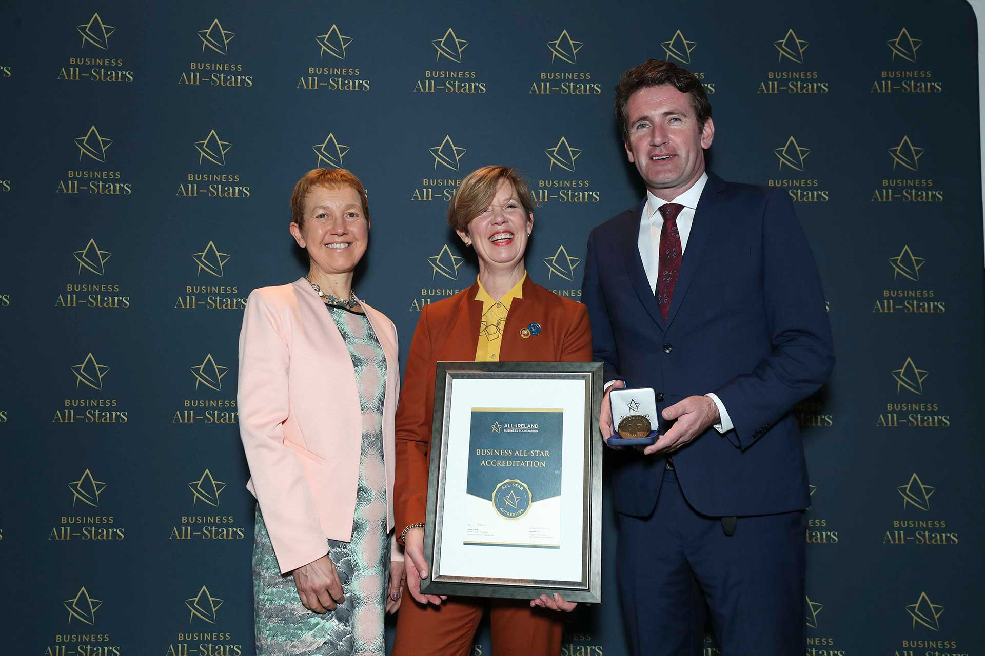 Maria Macklin, House of Colour receiving Business All-Star Accreditation at Croke Park from Dr Briga Hynes, Kemmy Business School, University of Limerick and Senator Aodhán Ó Ríordáin, Spokesperson on Education and Skills, Gaeilge and the Gaeltacht.