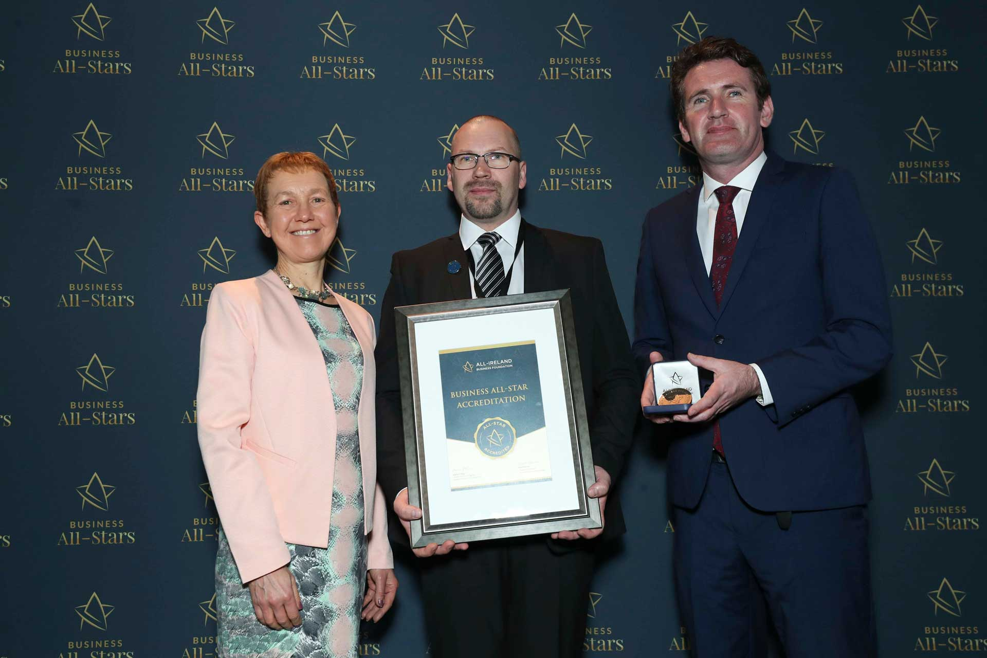 Albertas Kukys, SkyTech receiving Business All-Star Accreditation at Croke Park from Dr Briga Hynes, Kemmy Business School, University of Limerick and Senator Aodhán Ó Ríordáin, Spokesperson on Education and Skills, Gaeilge and the Gaeltacht.