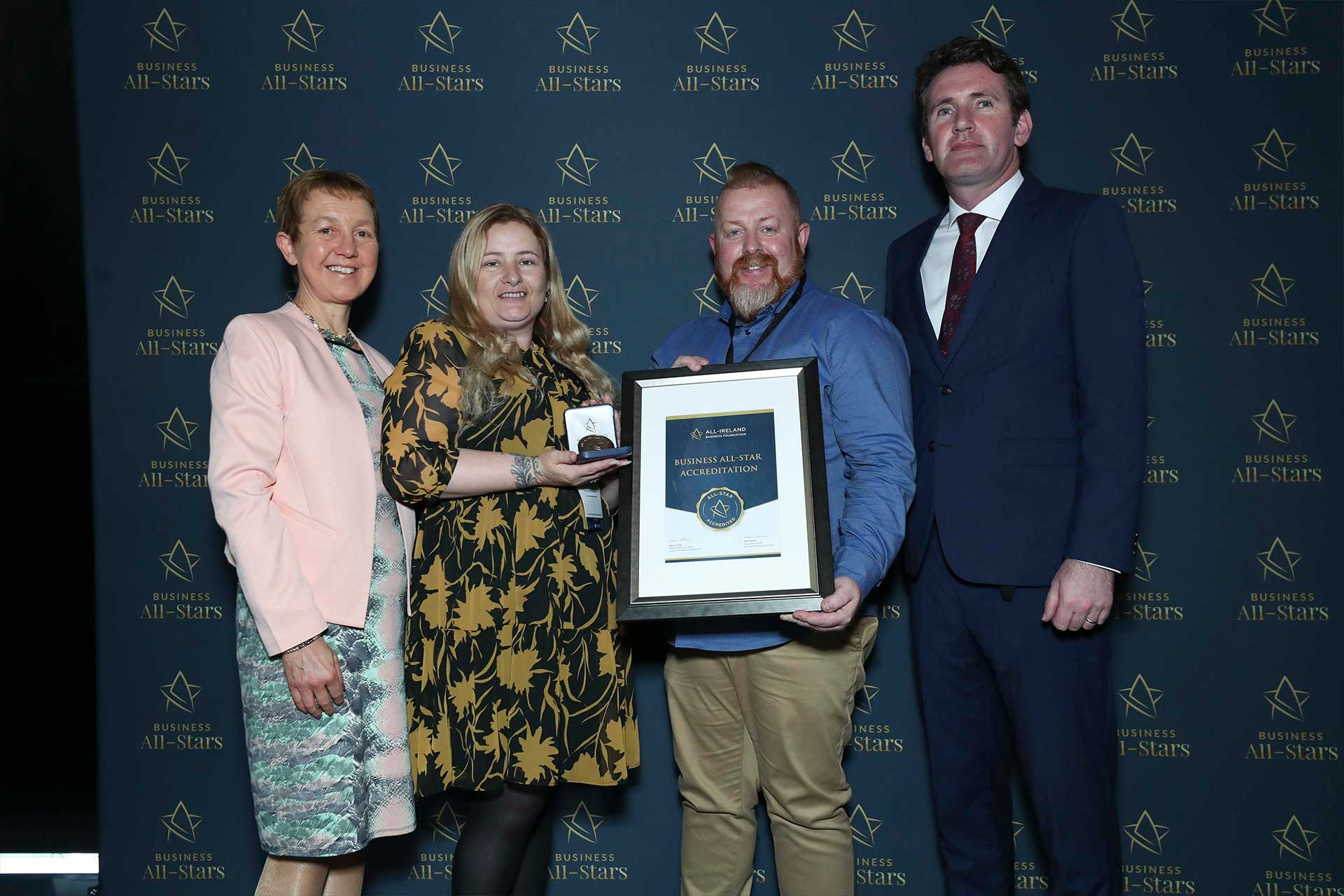 Katie & Anthony Sheehy - Irish Whiskey Auctions receiving Business All-Star Accreditation at Croke Park from Dr Briga Hynes, Kemmy Business School, University of Limerick and Senator Aodhán Ó Ríordáin, Spokesperson on Education and Skills, Gaeilge and the Gaeltacht.