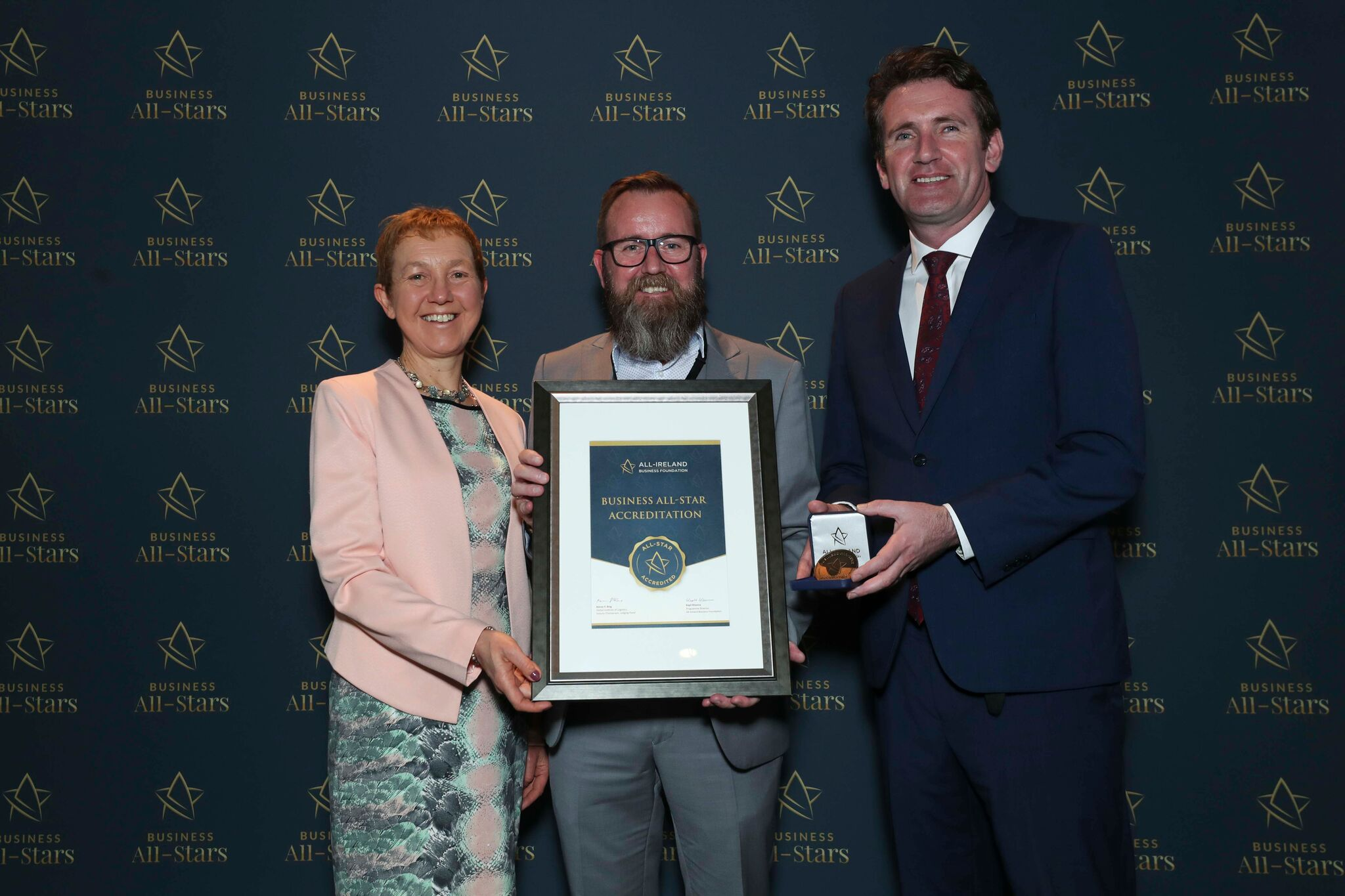 Ciaran Clarke - Roches Barbershop & Shaving Saloon receiving Business All-Star Accreditation at Croke Park from Dr Briga Hynes, Kemmy Business School, University of Limerick and Senator Aodhán Ó Ríordáin, Spokesperson on Education and Skills, Gaeilge and the Gaeltacht.