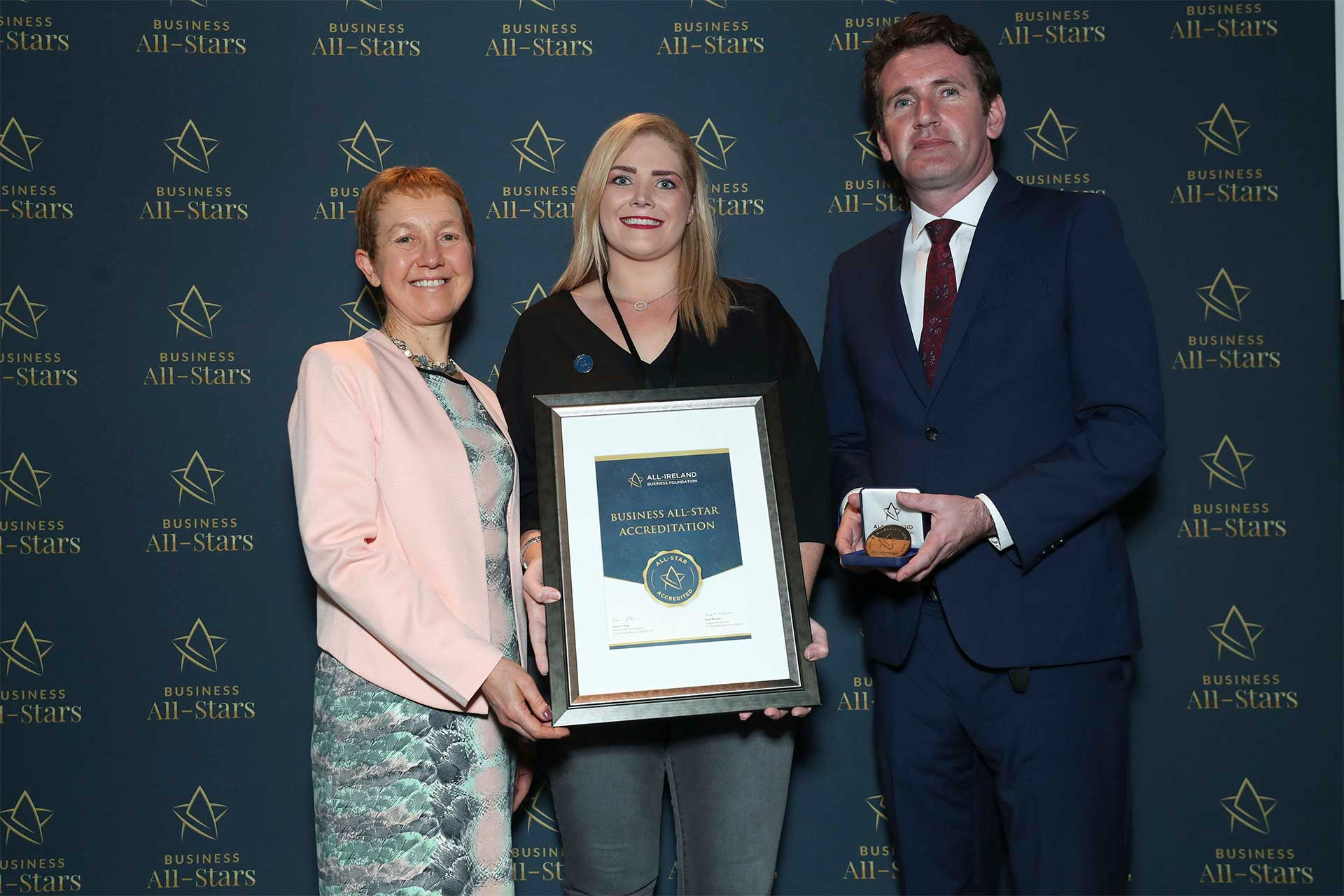 Siobhan McGrath - Zenith Hairdressing Claregalway receiving Business All-Star Accreditation at Croke Park from Dr Briga Hynes, Kemmy Business School, University of Limerick and Senator Aodhán Ó Ríordáin, Spokesperson on Education and Skills, Gaeilge and the Gaeltacht.