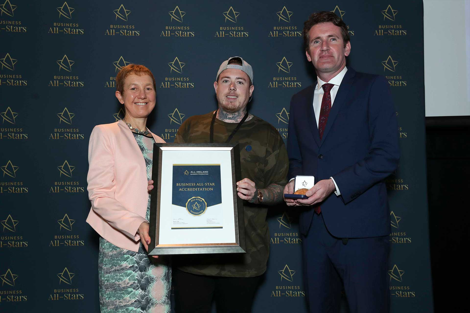 Gerard Burke - Flux Athletic receiving Business All-Star Accreditation at Croke Park from Dr Briga Hynes, Kemmy Business School, University of Limerick and Senator Aodhán Ó Ríordáin, Spokesperson on Education and Skills, Gaeilge and the Gaeltacht.