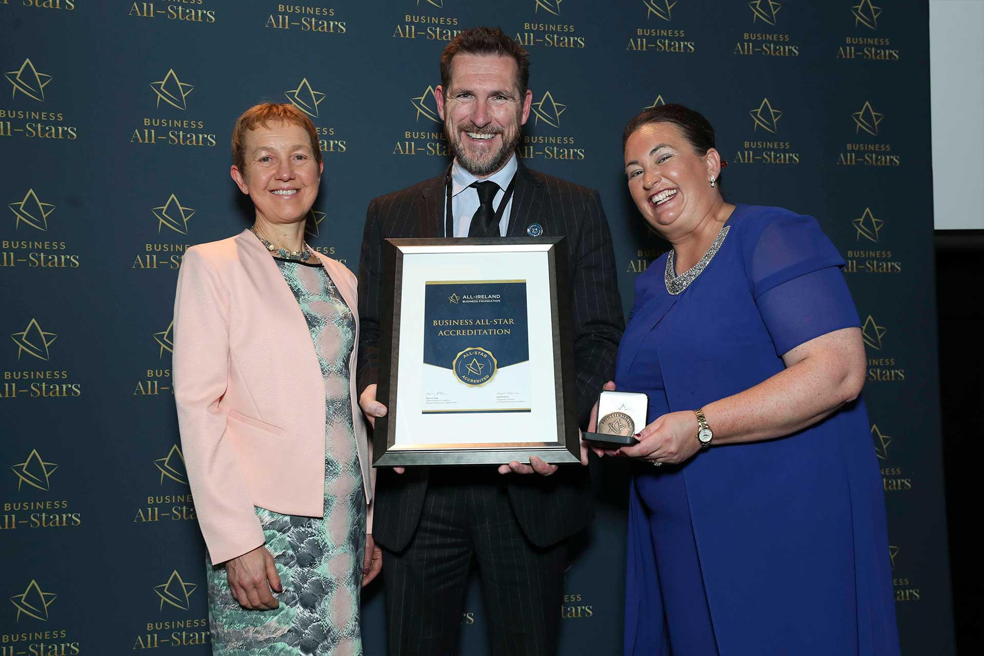 John Waters - Phonovation receiving Business All-Star Accreditation at Croke Park from Dr Briga Hynes, Kemmy Business School, University of Limerick and Elaine Carroll CEO, All-Ireland Business Foundation.