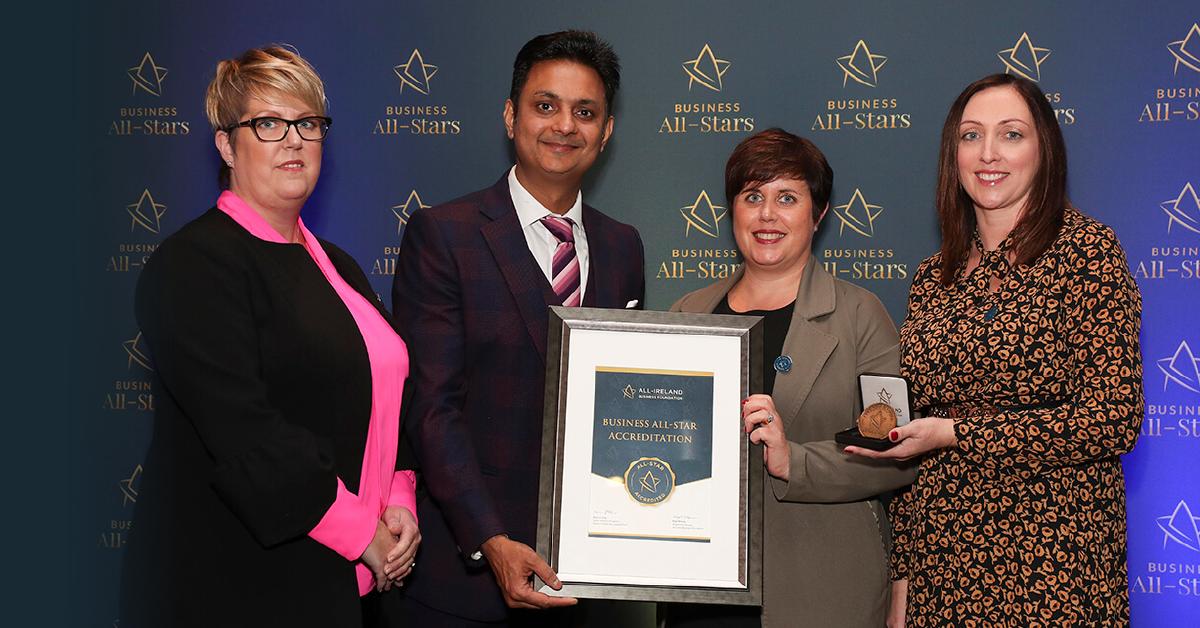 Joanne Keane, Elaine Culligan & Rebecca McGee - LIA receiving Business All-Star Accreditation from Kapil Khanna, MD, AIBF at Croke Park