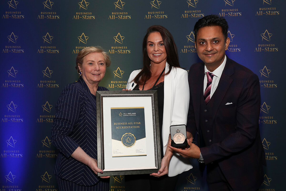 CAPTION: Jane Swarbrigg - Inglot Cosmetics, receiving All-Star Retailer of the Year Accreditation from Frances Fitzgerald, MEP, and Kapil Khanna, MD, AIBF at Croke Park