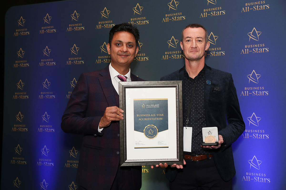 CAPTION: Paul Tobin - Paul Tobin Estate Agents receiving Business All-Star Thought Leader Accreditation from Kapil Khanna, MD, AIBF at Croke Park