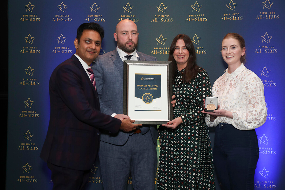 CAPTION: Tim Lennon & team - Sonica, receiving Business All-Star Accreditation from Kapil Khanna, MD, AIBF at Croke Park