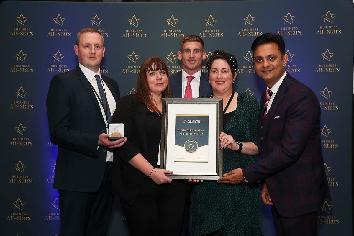 CAPTION: Michael Stafford & Team - Stafford Bonded, receiving Business All-Star Accreditation from Kapil Khanna, MD, AIBF at Croke Park