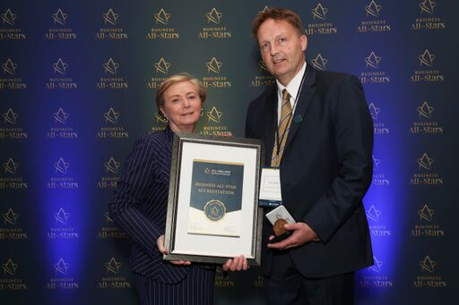 CAPTION: Noel Ahern - Acorn Veterinary Clinic, receiving Business All-Star Accreditation from Frances Fitzgerald, MEP, at Croke Park.