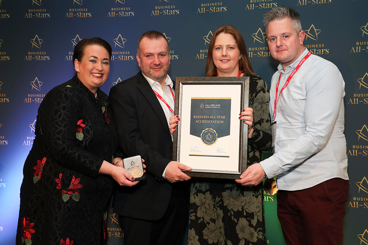 CAPTION: Laura & Denis Mullin & James Doyle - Doyle's Deli & Food 2 Go, receiving Business All-Star Accreditation from Elaine Carroll, CEO, All-Ireland Business Foundation at Croke Park.