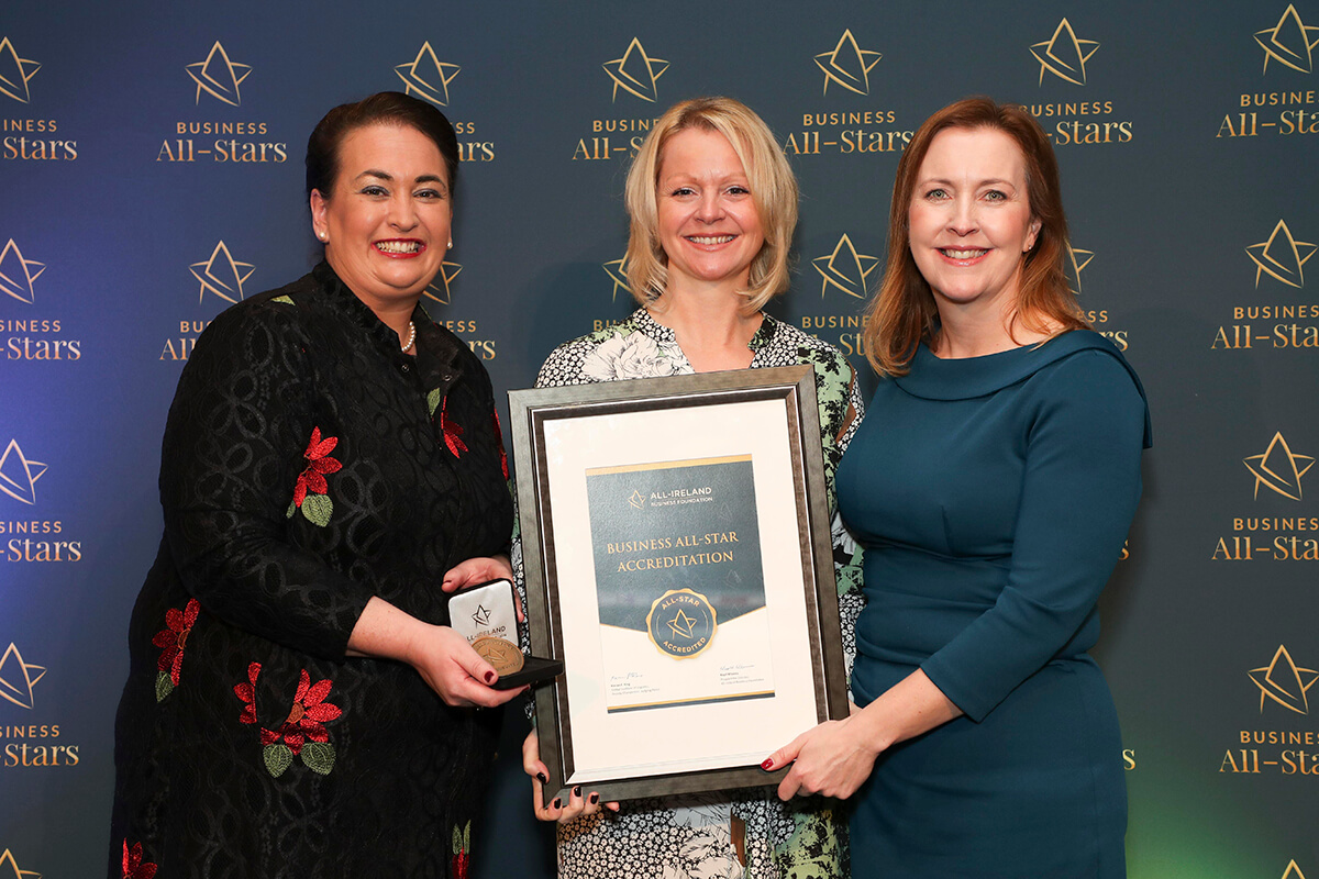 CAPTION: Eileen Fleming & Hedi Grimwood - FG Innovation Management, receiving Business All-Star Spa Management Company 2020 Accreditation from Elaine Carroll, CEO, All-Ireland Business Foundation at Croke Park.
