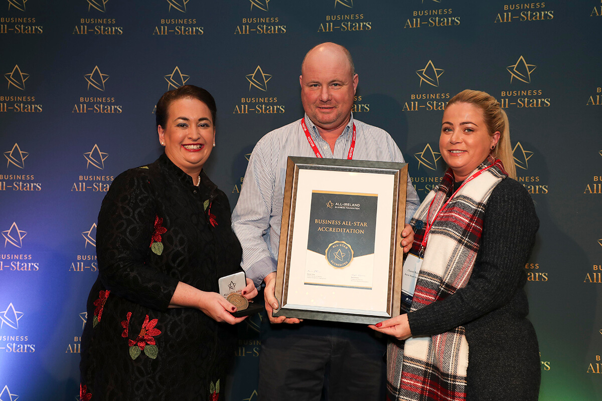 CAPTION: Chantel & Terry Kearns - Boyne Waste Services Ltd, receiving Business All-Star Accreditation from Elaine Carroll, CEO, All-Ireland Business Foundation at Croke Park.