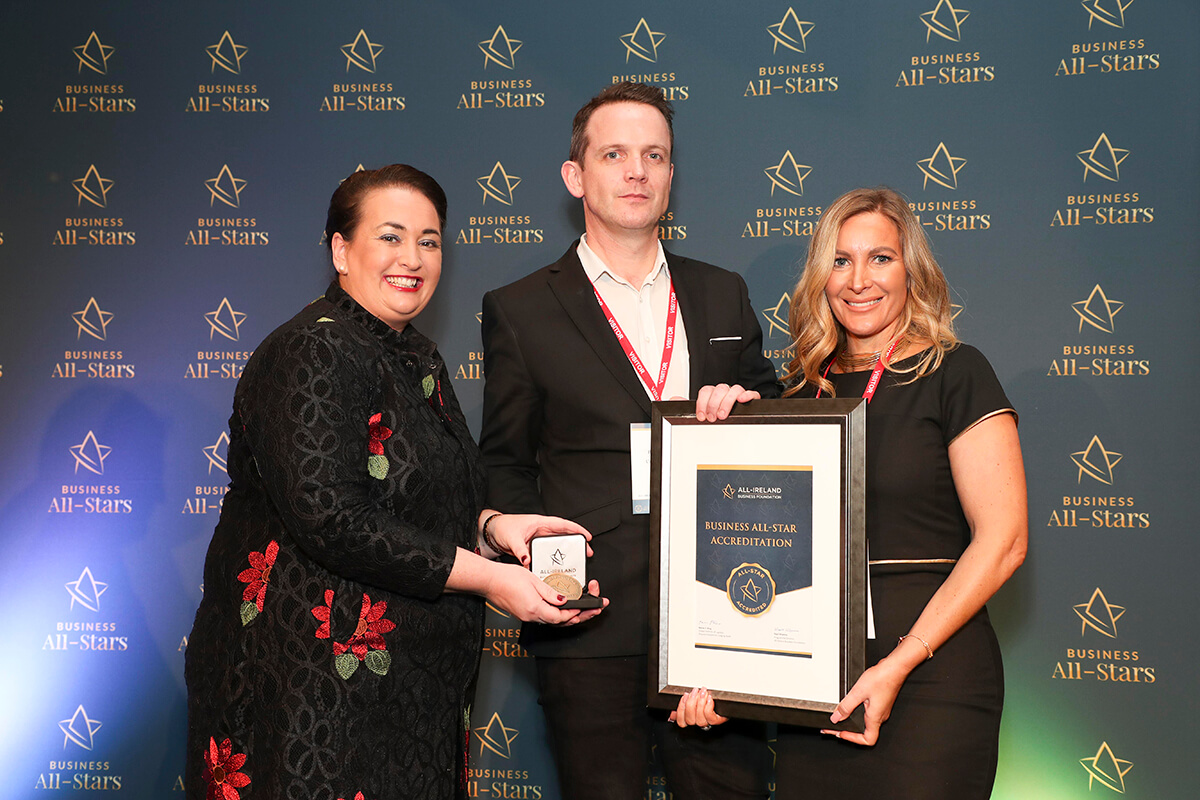 CAPTION: Barry McCabe & Chiara Keating - Uniformal Limited, receiving Business All-Star Accreditation from Elaine Carroll, CEO, All-Ireland Business Foundation at Croke Park.