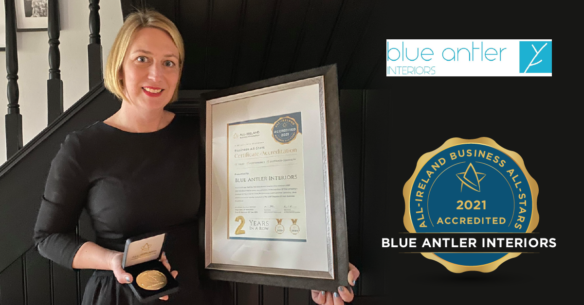 Maggie Diskin, Owner of Blue Antler Interiors with her All-Star Accreditation certificate and medallion.