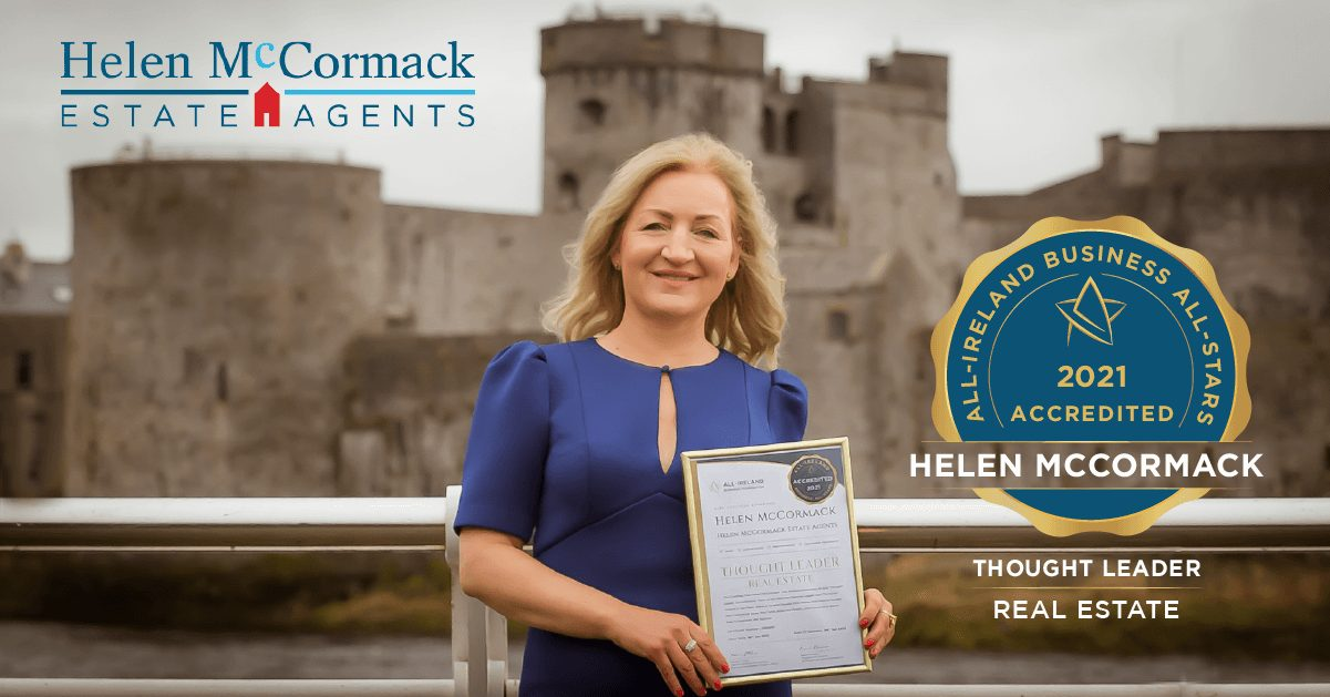 Helen McCormack photographed with her All-Star Accreditation certificate.