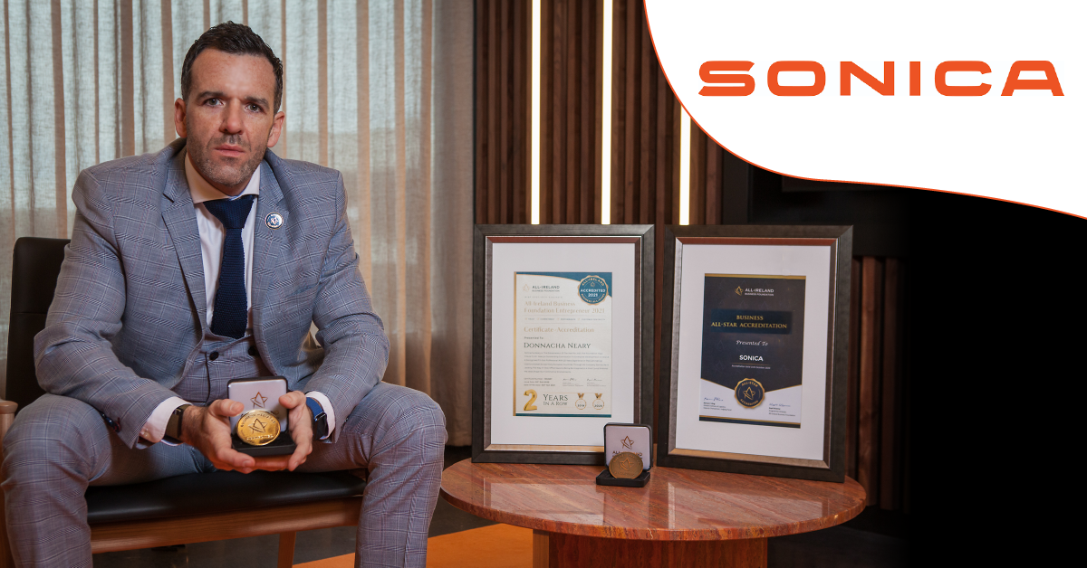 Donnacha Neary, Managing Director of Sonica photographed </br>with his All-Star Accreditation certificate and medallion.