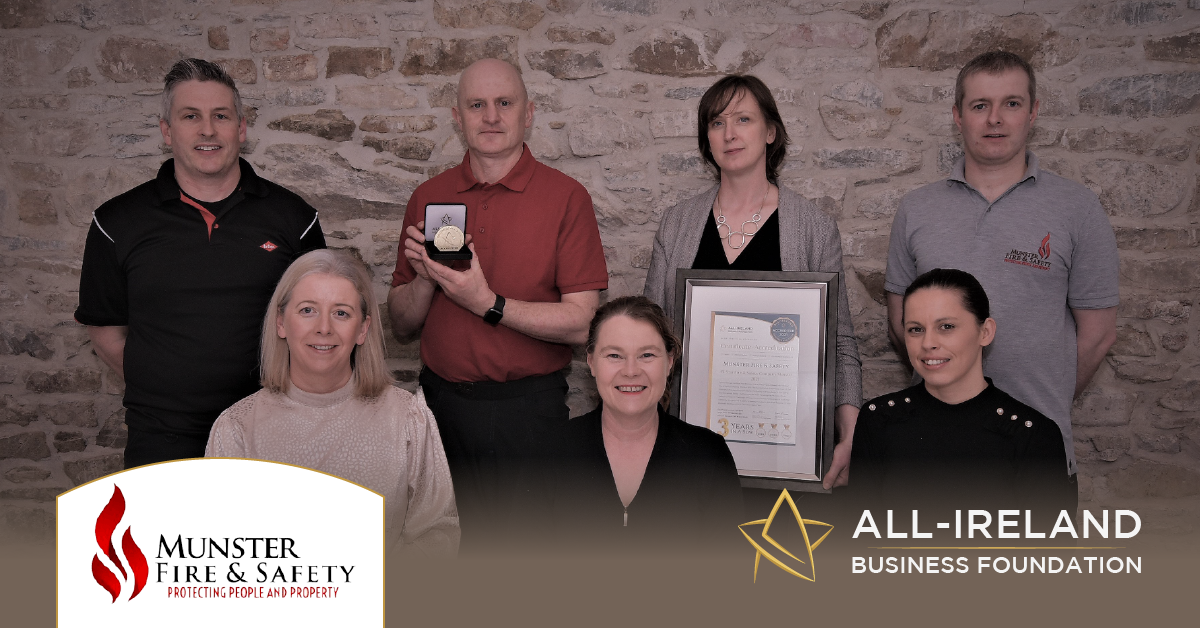 The Munster Fire and Safety team photographed with their All-Star Accreditation certificate and medallion.